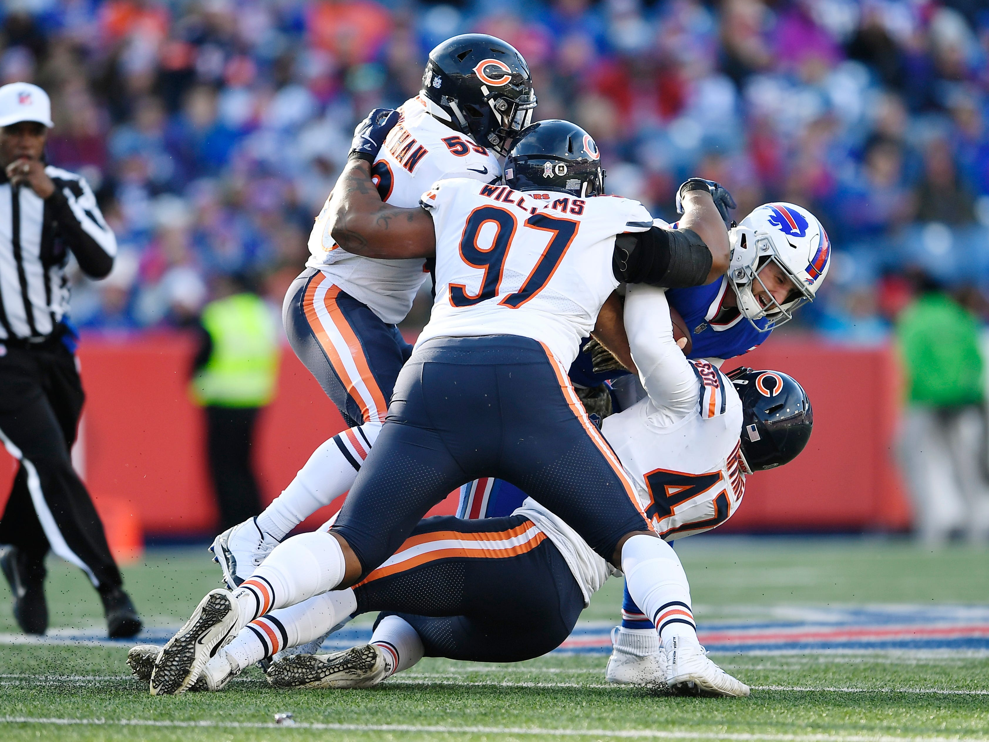 Chicago Bears defenders, led by Nick Williams (97), swallow up Buffalo Bills quarterback Nathan Peterman during the second half.