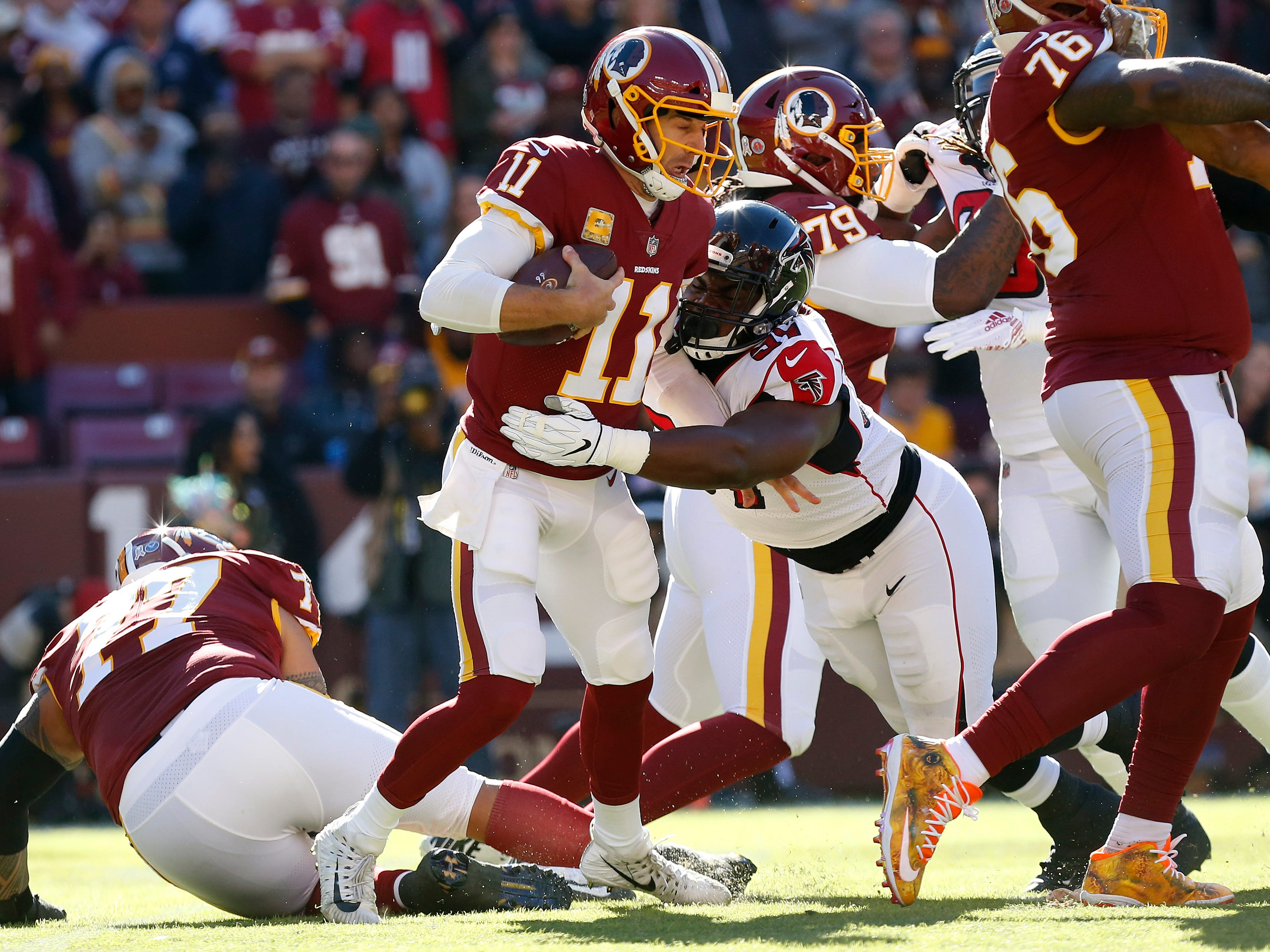 Atlanta Falcons defensive tackle Grady Jarrett (97) sacks Washington Redskins quarterback Alex Smith (11) in the first quarter at FedExField.