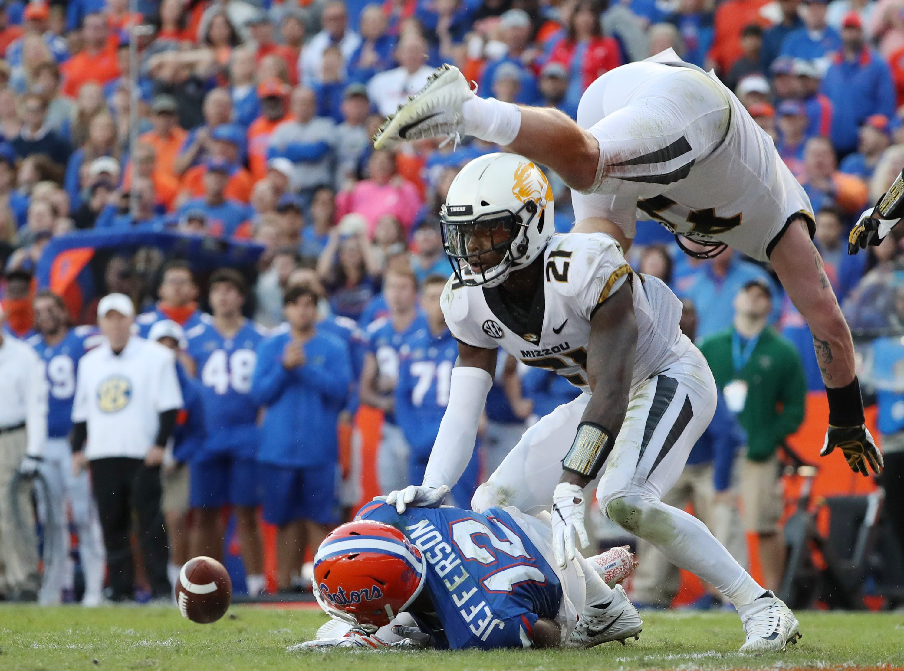Missouri Tigers defensive back Christian Holmes (21) and linebacker Cale Garrett (47) breaks up a pass indented for Florida Gators wide receiver Van Jefferson (12) during the second half at Ben Hill Griffin Stadium.