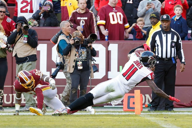 Falcons wide receiver Julio Jones breaks into the end zone for his first touchdown of the season.
