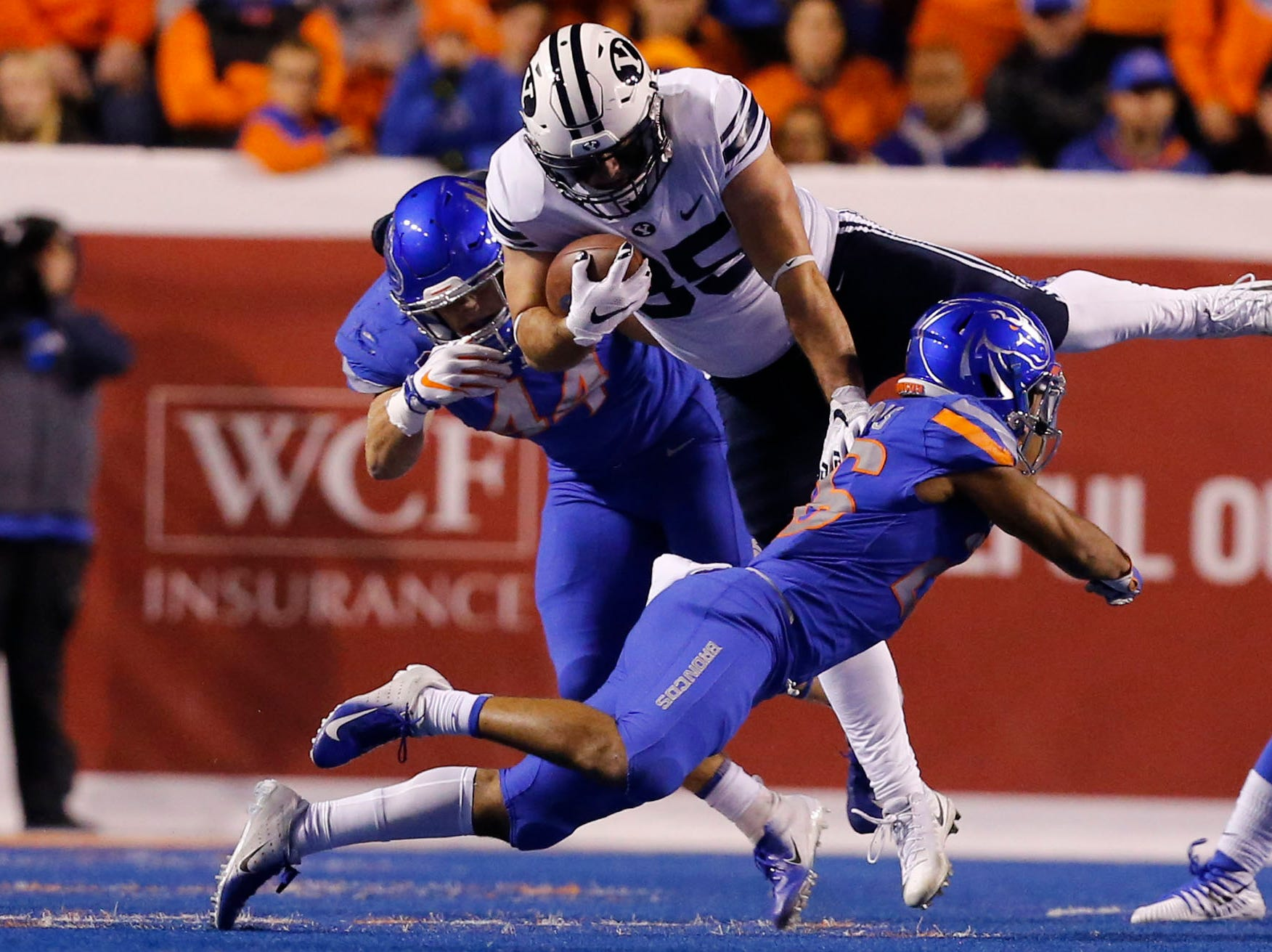Brigham Young Cougars running back Brayden El-Bakri (35) is upended by Boise State Broncos cornerback Avery Williams (26) during the first half of play at Albertsons Stadium.