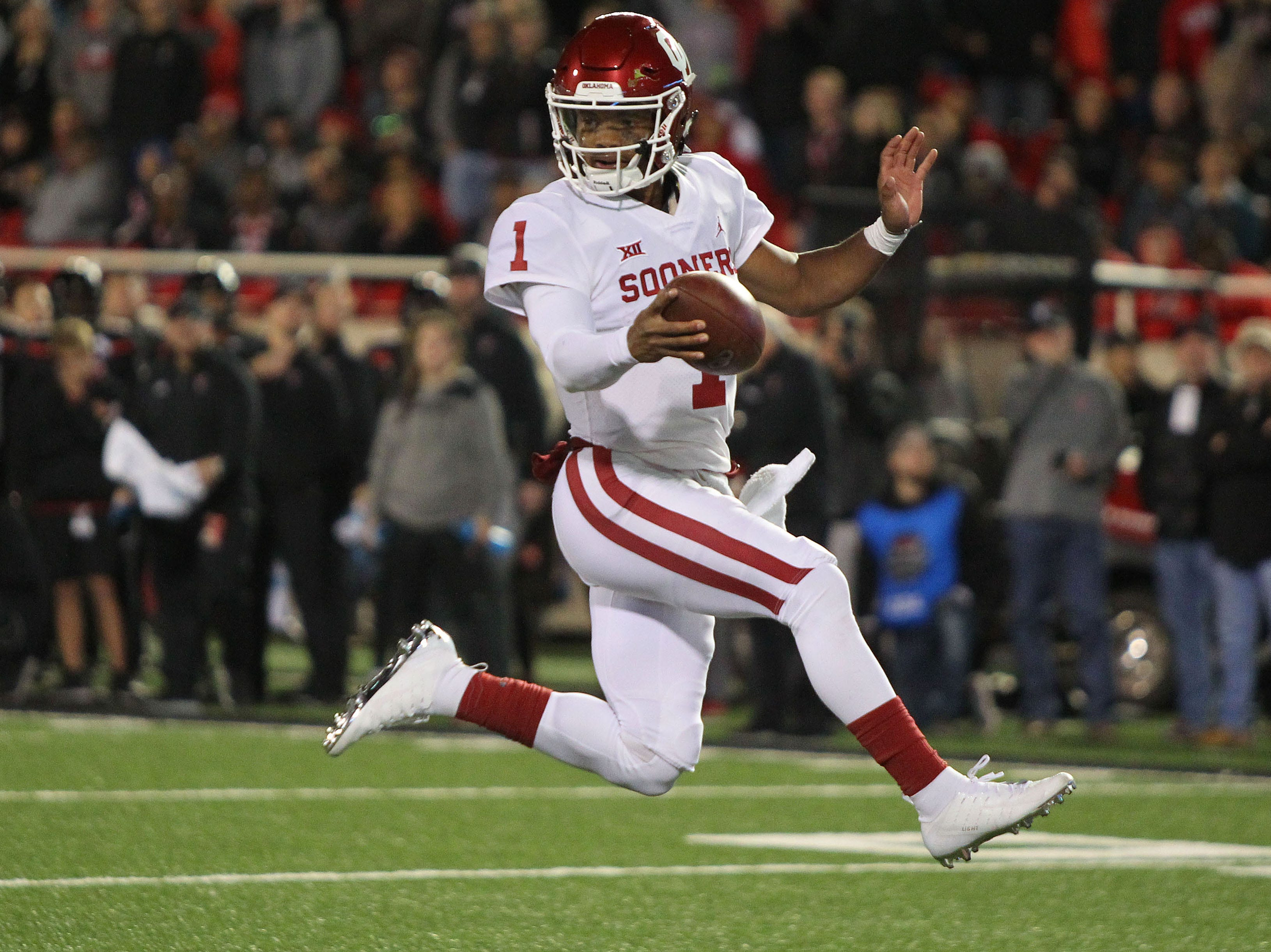Oklahoma Sooners quarterback Kyler Murray (1) leaps into the end zone against the Texas Tech Red Raiders at Jones AT&T Stadium.