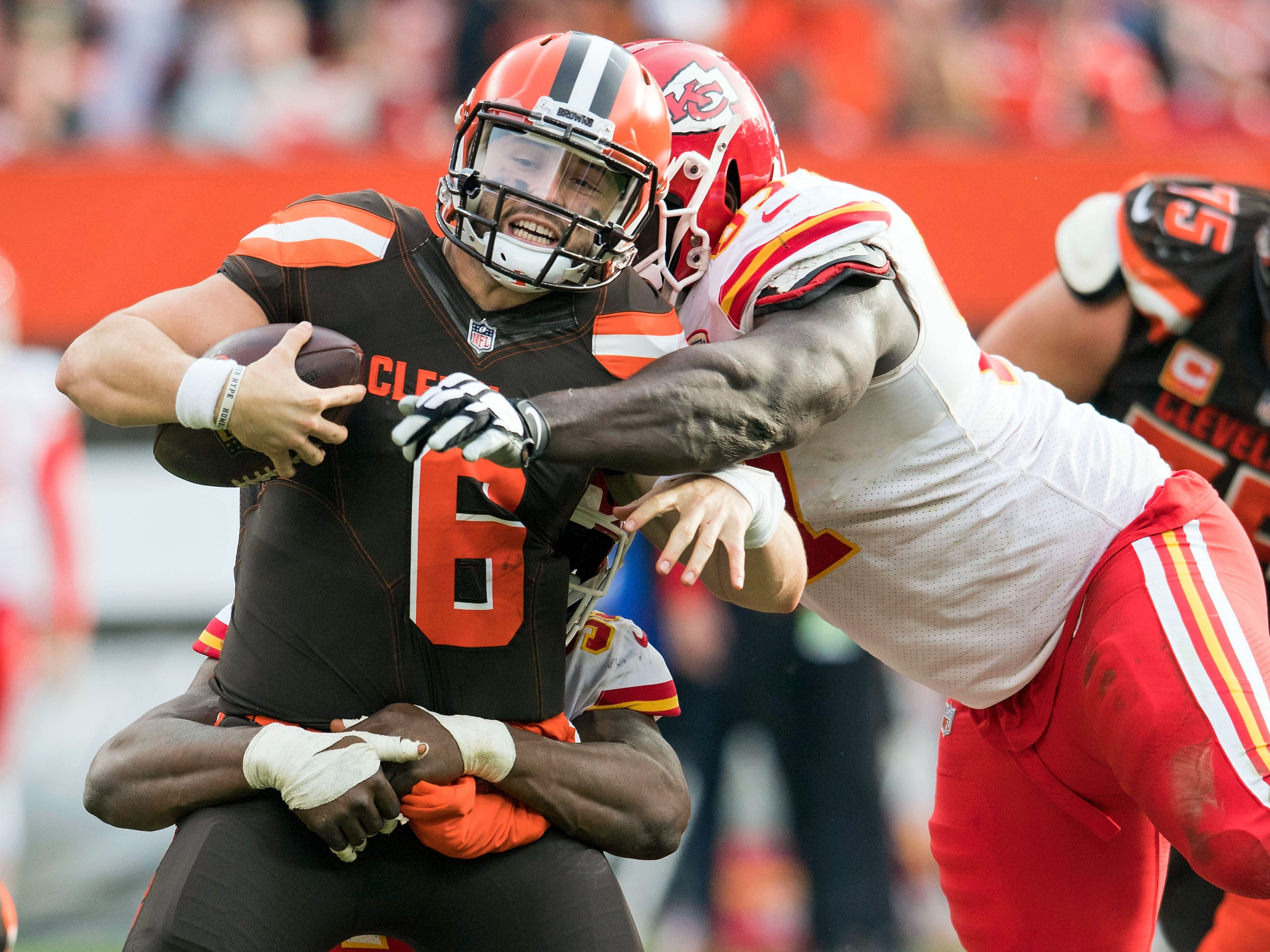 Kansas City Chiefs outside linebacker Dee Ford (55) and defensive end Allen Bailey (97) sack Cleveland Browns quarterback Baker Mayfield (6) during the second half at FirstEnergy Stadium.