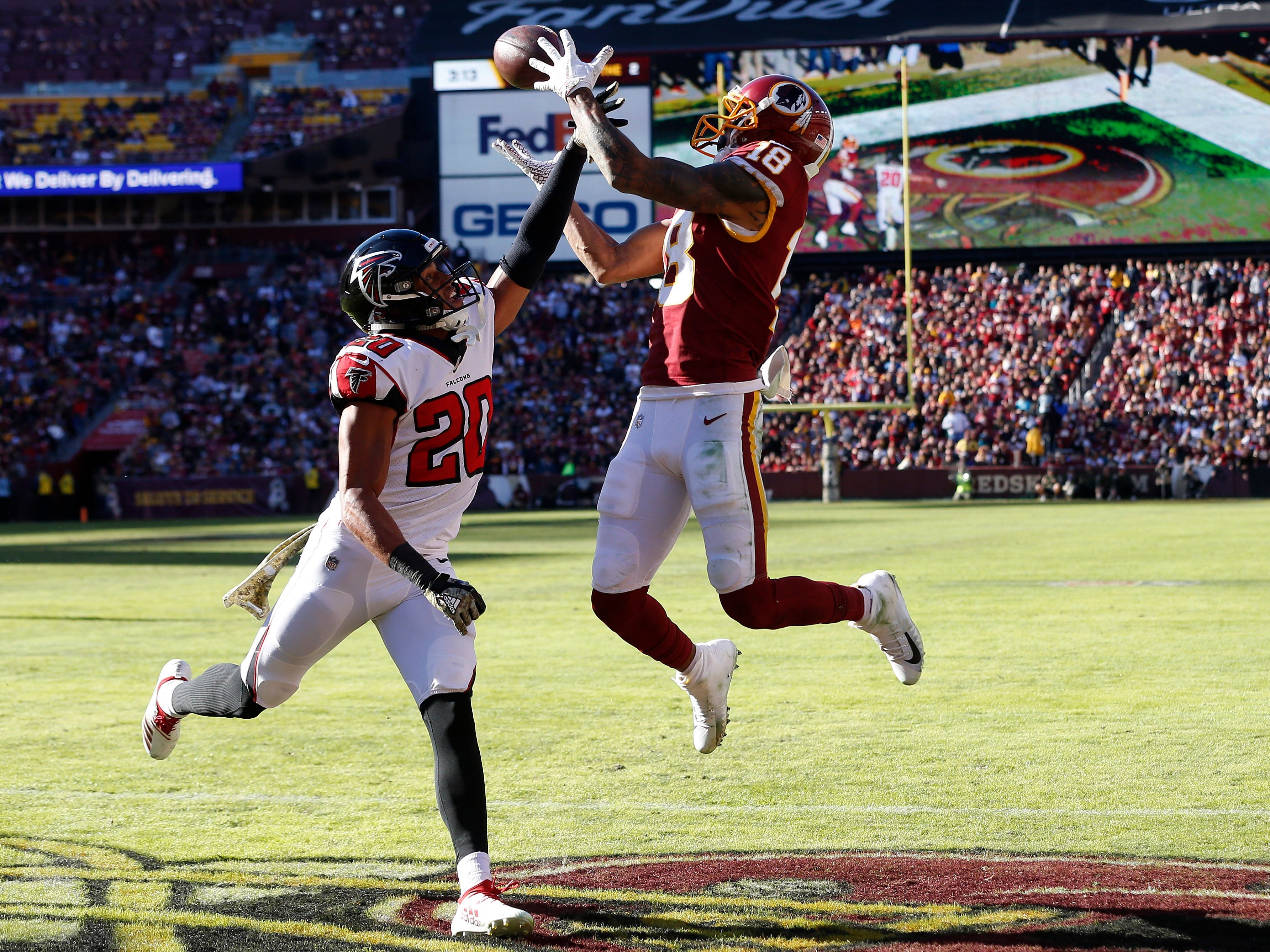 Washington Redskins wide receiver Josh Doctson (18) catches a touchdown pass over Atlanta Falcons free safety Isaiah Oliver (20) in the second quarter at FedExField.