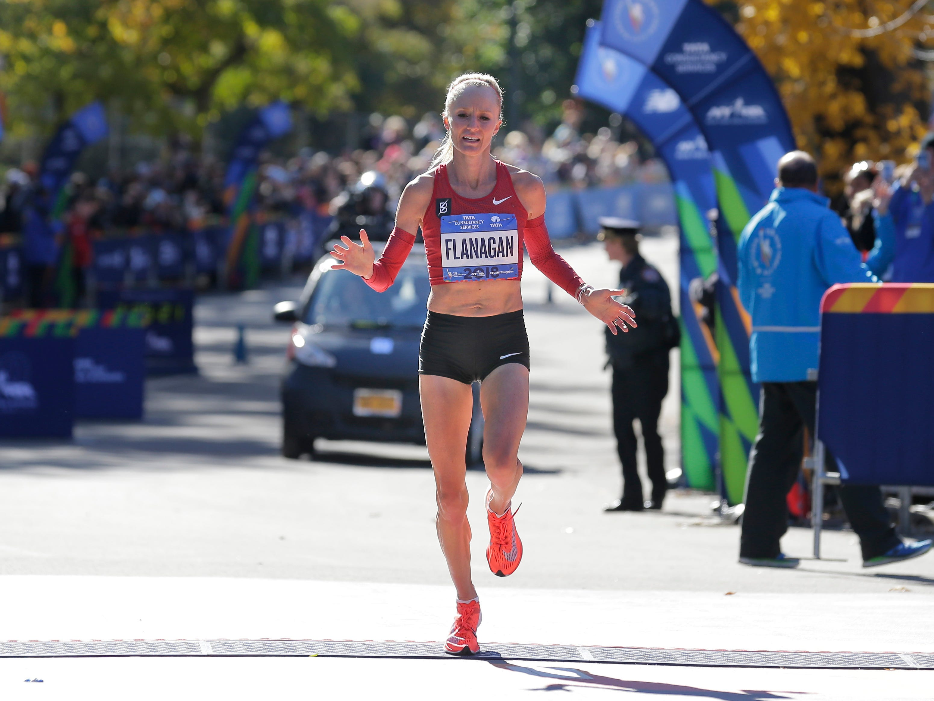 Shalane Flanagan, the defending champion from the United States, crosses the finish line third in the women's division of the New York City Marathon.