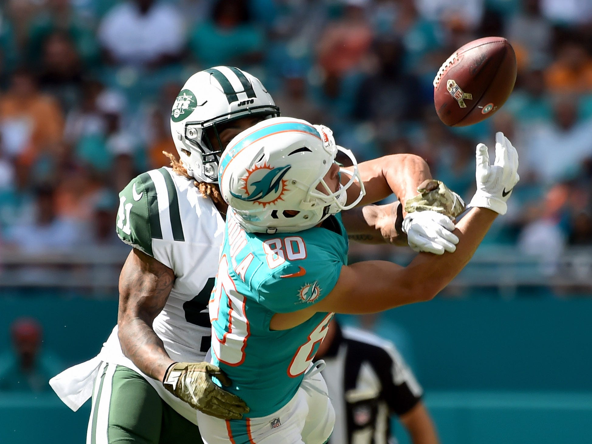 Miami Dolphins wide receiver Danny Amendola (80) can't make the catch in front of New York Jets cornerback Buster Skrine (41) during the first half at Hard Rock Stadium.