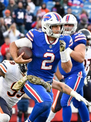 Buffalo Bills quarterback Nathan Peterman (2) runs out of the pocket against the Chicago Bears during the fourth quarter at New Era Field.