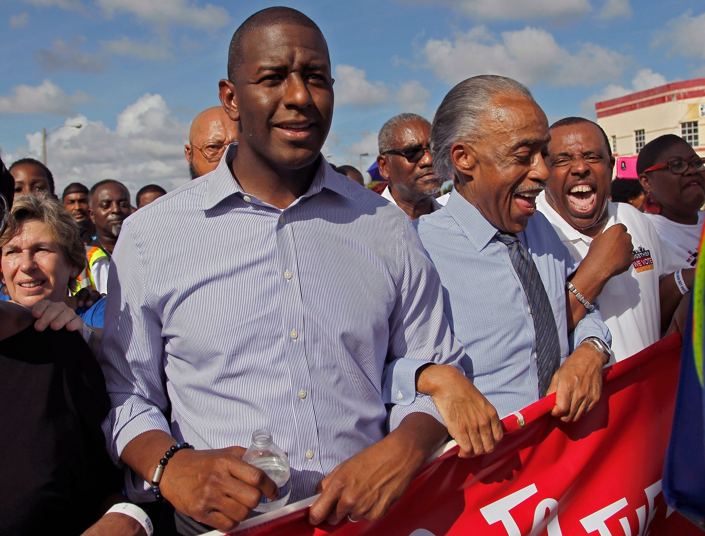 "Florida Democratic gubernatorial candidate Andrew Gillum, left, marches to the Caleb Center arm-locked with Rev. Al Sharpton, second from the left, and local politicians and supporters, as part of the ""Souls to the Polls"" one of many events prior to the elections on Sunday, Nov. 4, 2018."