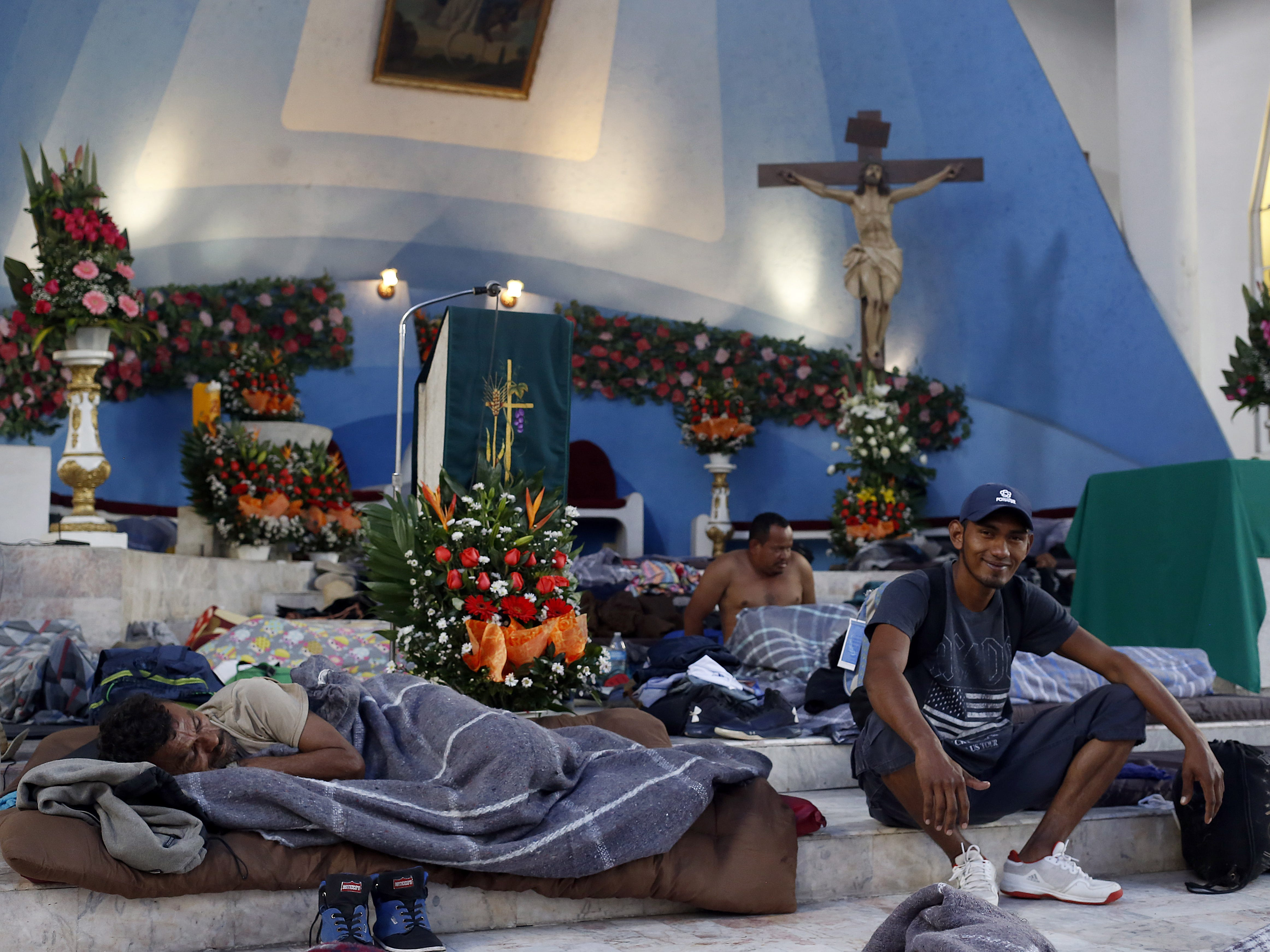Members of the migrant caravan rest in a church upon their arrival in the city of Puebla, Mexico, Nov. 4, 2018.