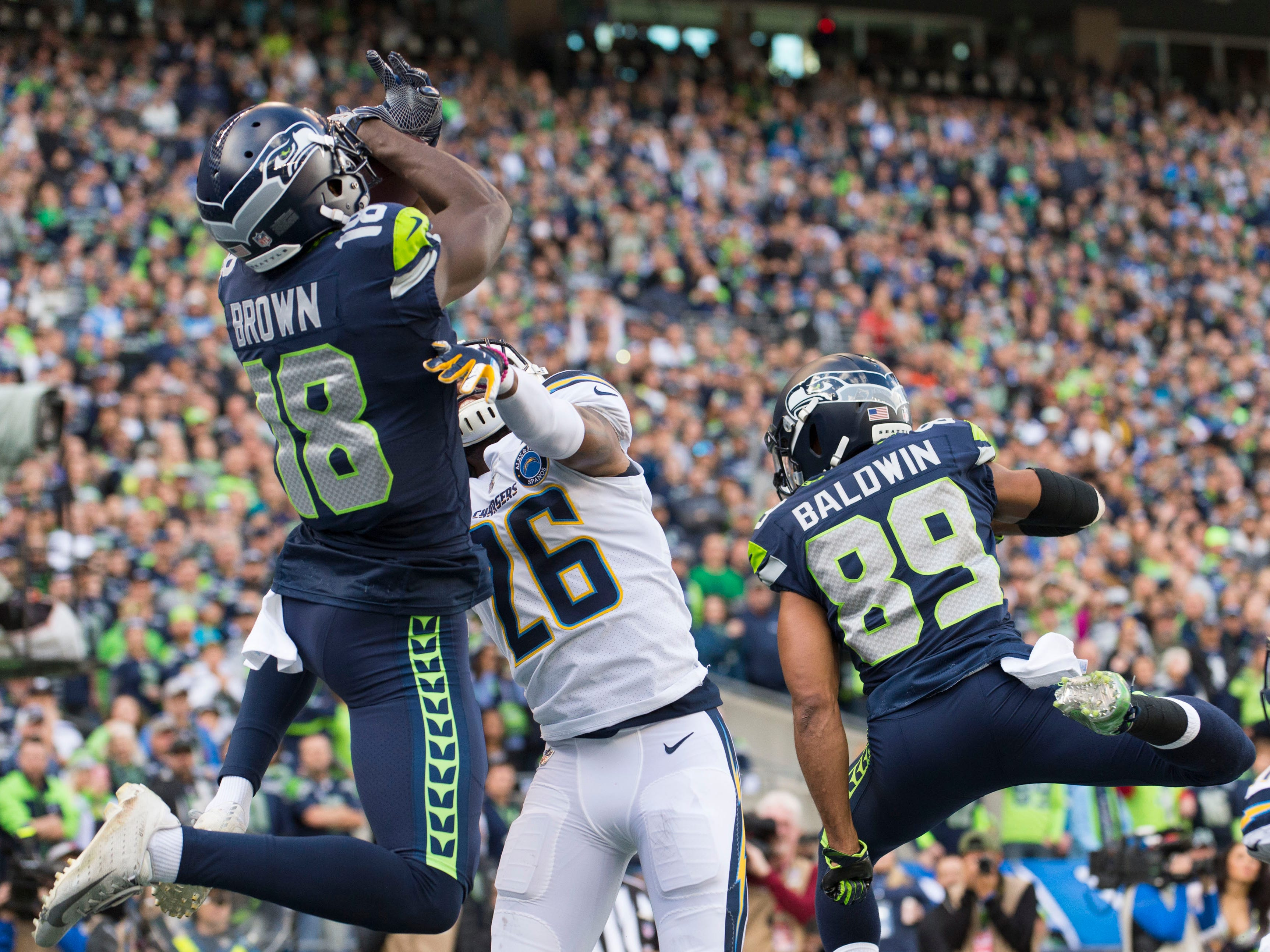 Seattle Seahawks wide receiver Jaron Brown (18) catches a touchdown pass against the Los Angeles Chargers during the first half at CenturyLink Field.