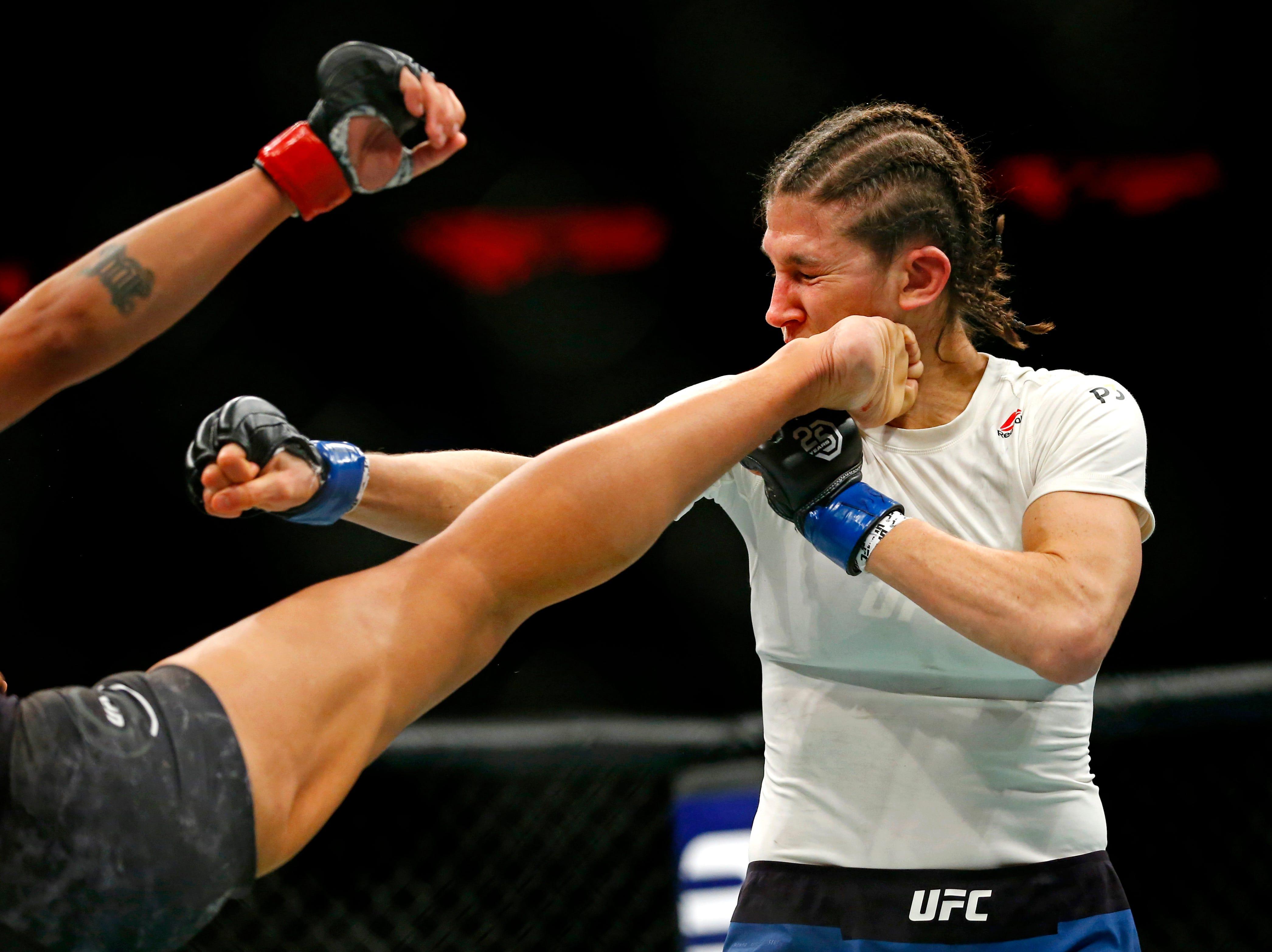 Sijara Eubanks (red gloves) fights Roxanne Modafferi (blue gloves) during UFC 230 at Madison Square Garden.