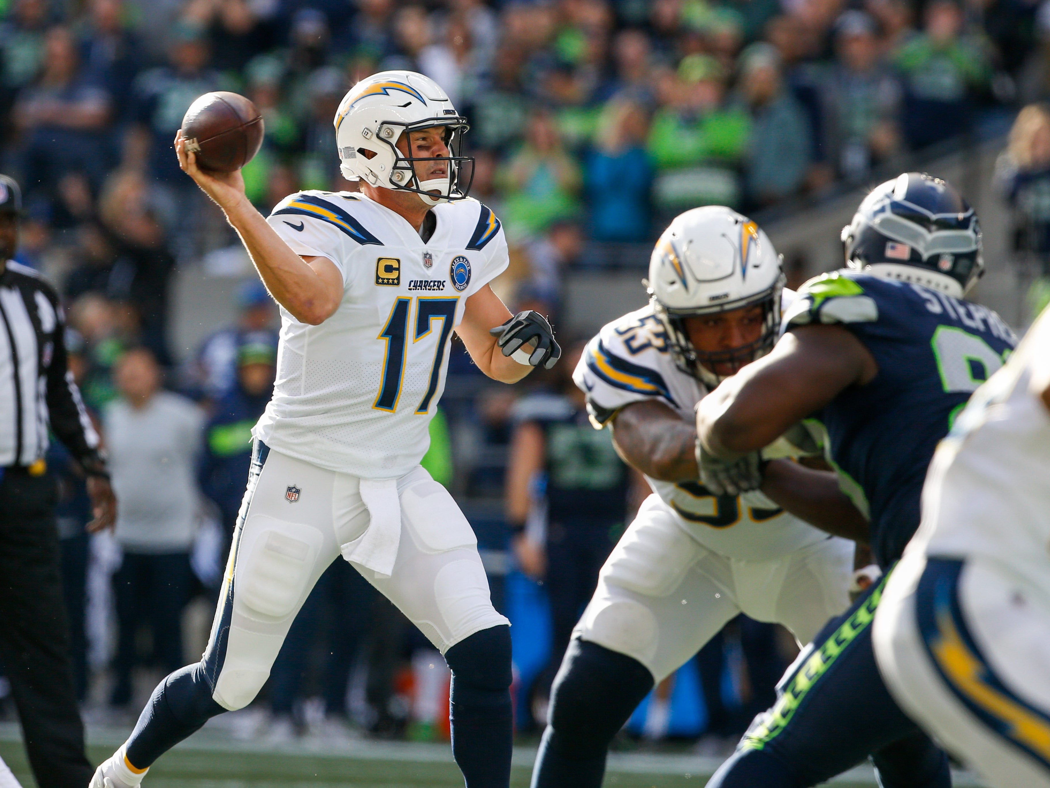 Los Angeles Chargers quarterback Philip Rivers (17) drops back to pass against the Seattle Seahawks in  the first quarter at CenturyLink Field. 20181104_lbm_sn8_038.JPG