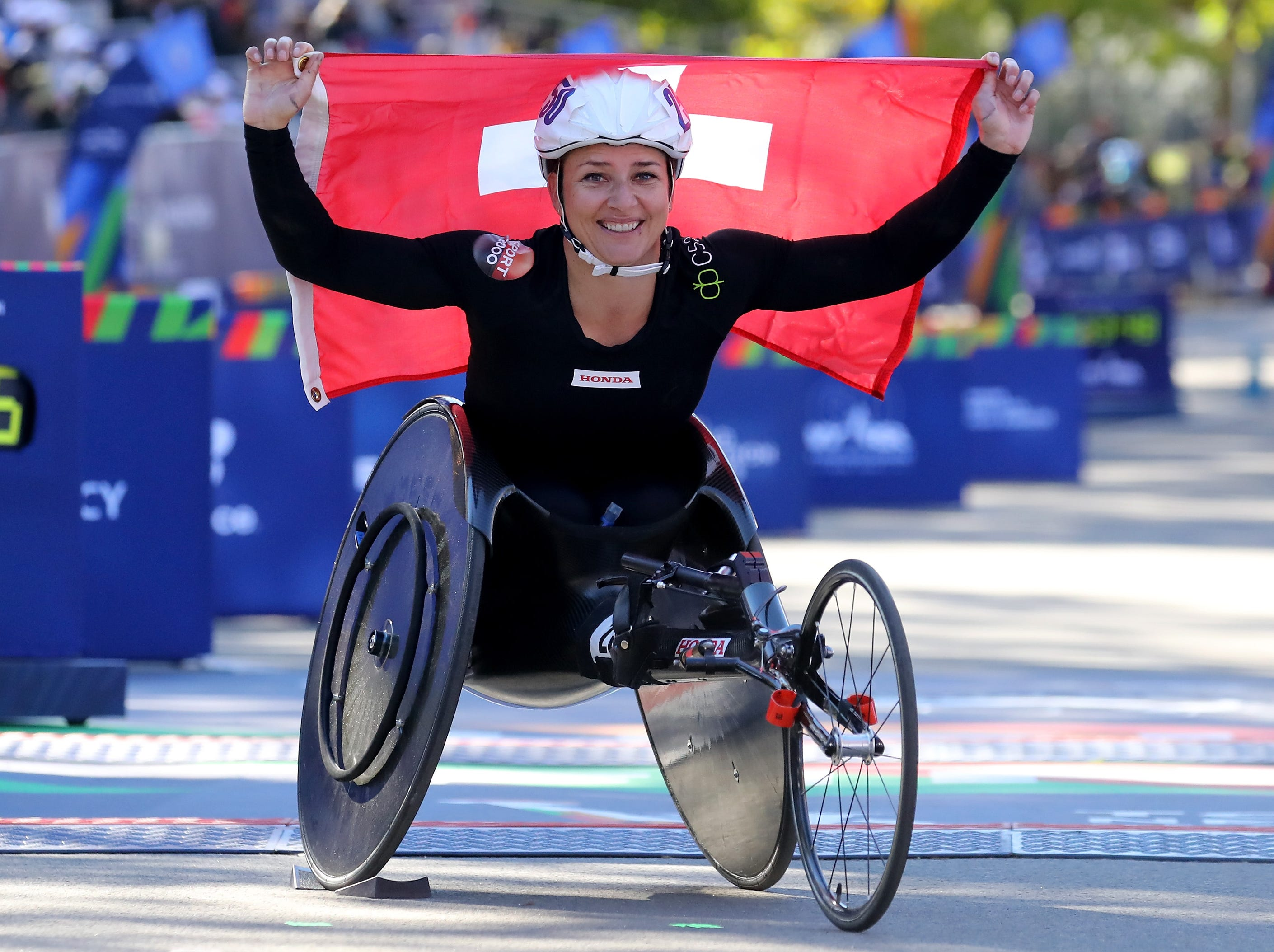 Manuela Schar of Switzerland celebrates her victory in the women's wheelchair division during the 2018 TCS New York City Marathon on Nov. 4.