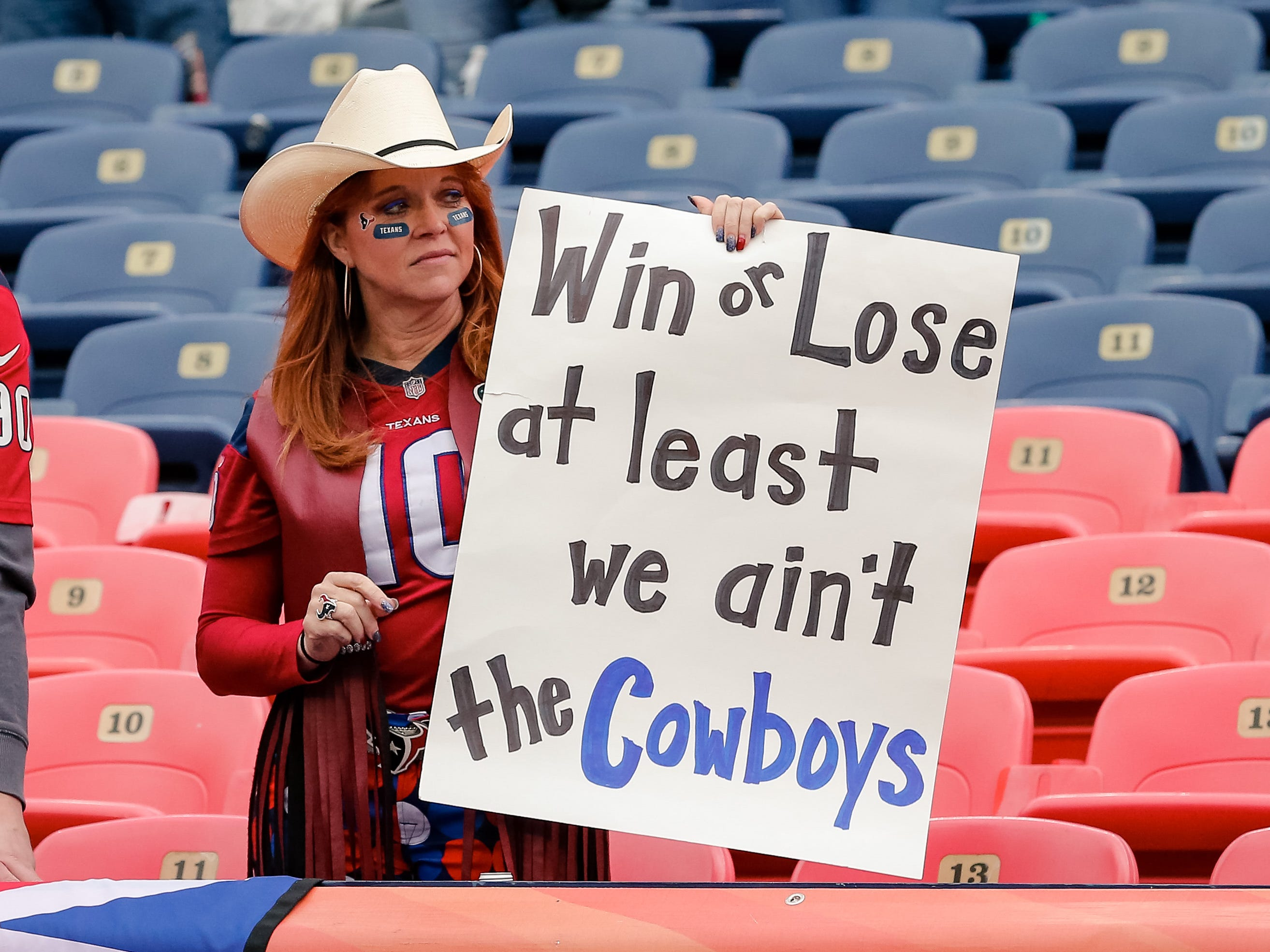 A Houston Texans fan holds up a sign before a game against the Denver Broncos at Broncos Stadium at Mile High.