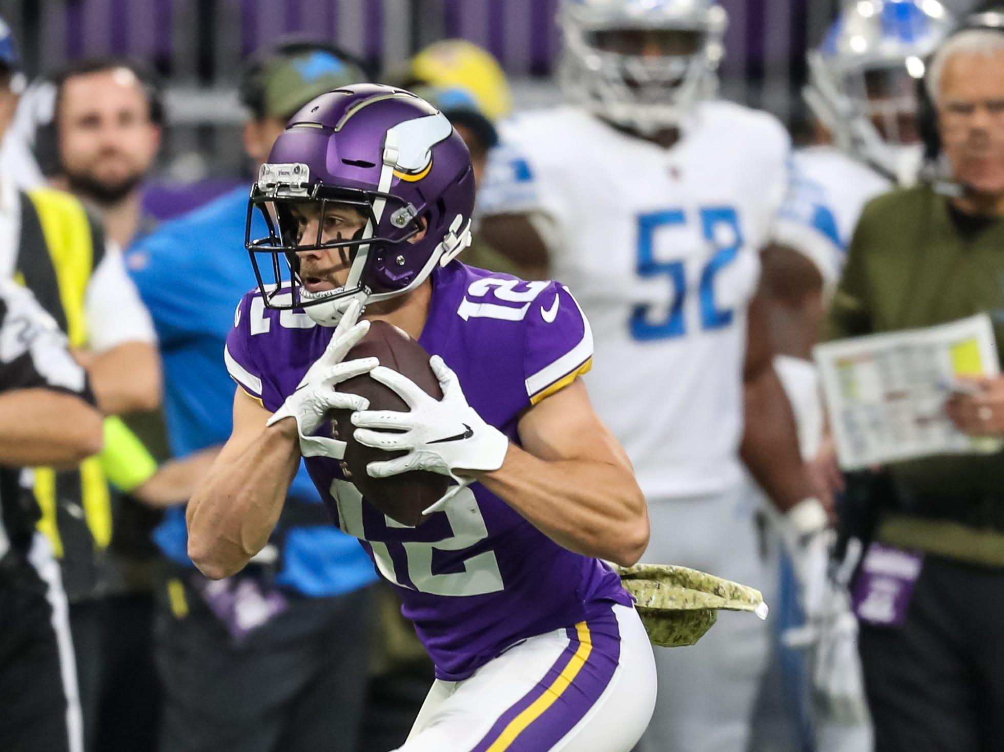 Minnesota Vikings wide receiver Chad Beebe (12) hauls in a pass during the first quarter against the Detroit Lions at U.S. Bank Stadium.