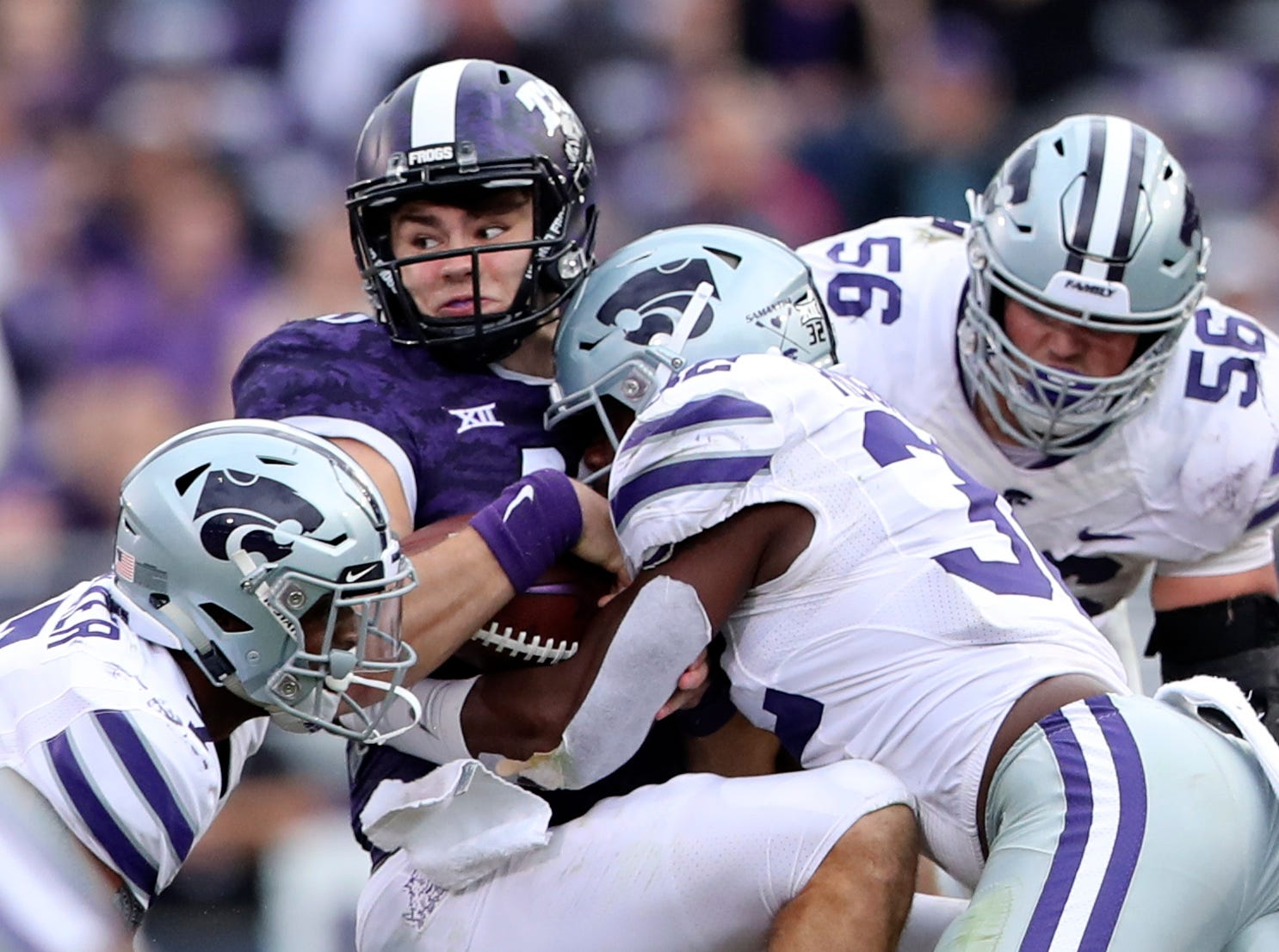 TCU Horned Frogs quarterback Michael Collins (10) is tackled by Kansas State Wildcats linebacker Justin Hughes (32) and defensive end Wyatt Hubert (56) during the second half at Amon G. Carter Stadium.