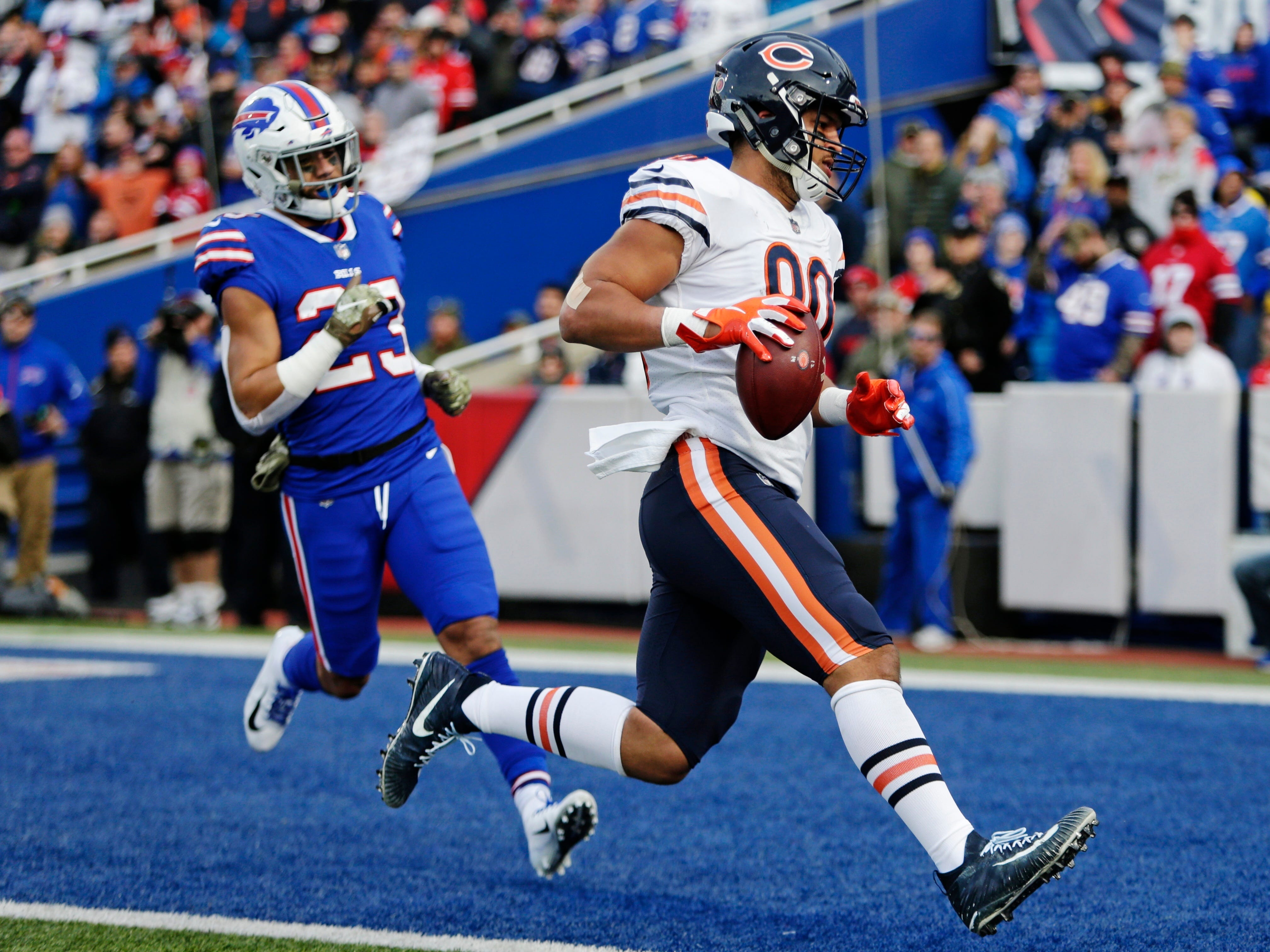 Chicago Bears tight end Trey Burton (80) runs past Buffalo Bills' Micah Hyde (23) for a touchdown during the second half.