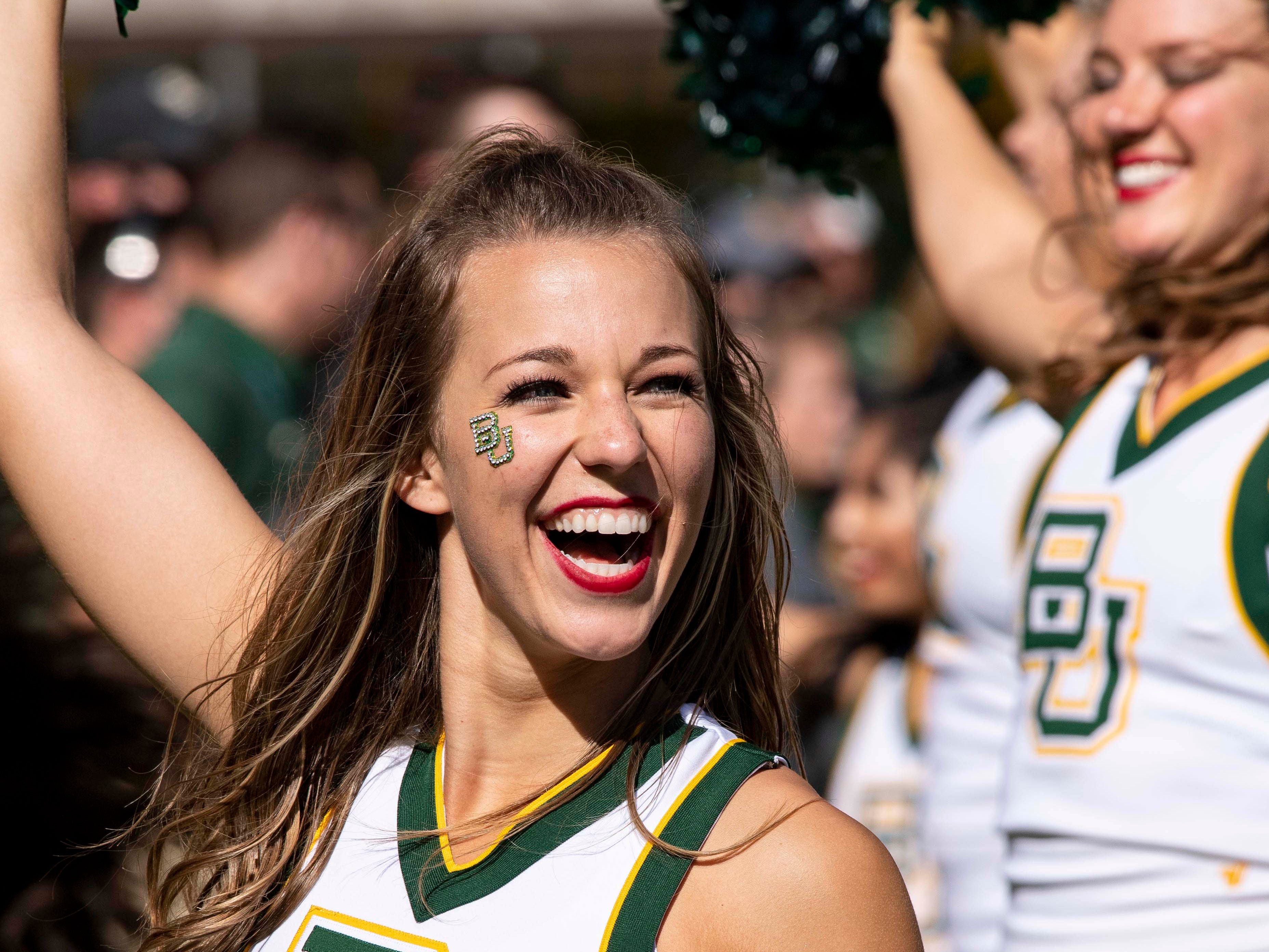 Week 10: A Baylor Bears cheerleader performs during the second half of the game against the Oklahoma State Cowboys at McLane Stadium.
