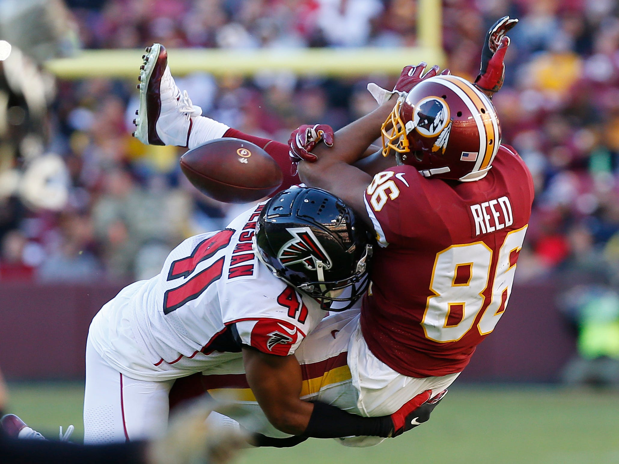 Atlanta Falcons defensive back Sharrod Neasman (41) breaks up a pass intended for Washington Redskins tight end Jordan Reed (86) in the third quarter at FedExField.