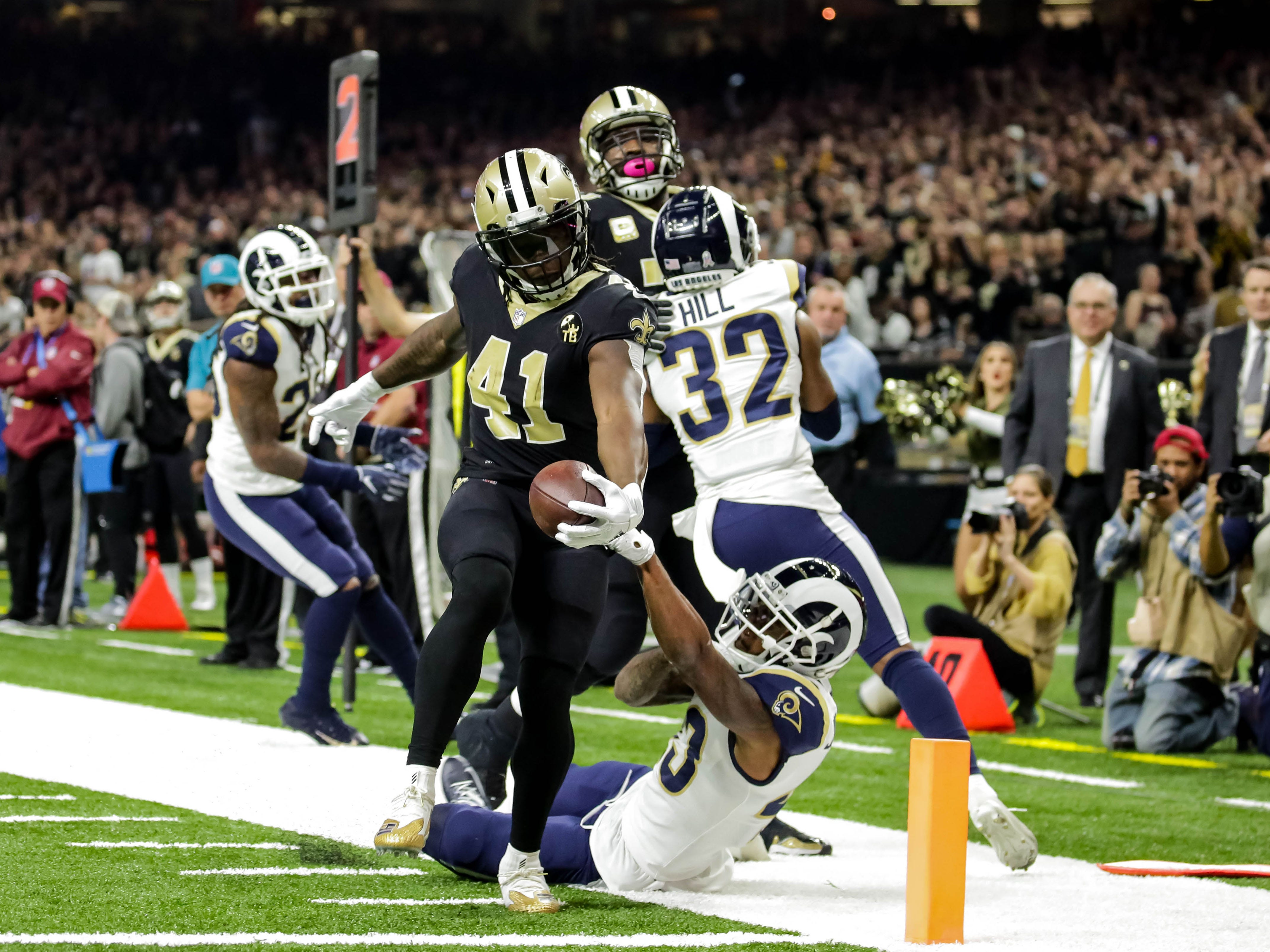 New Orleans Saints running back Alvin Kamara (41) breaks a tackle by Los Angeles Rams strong safety John Johnson (43) to score a touchdown in the first quarter at the Mercedes-Benz Superdome.