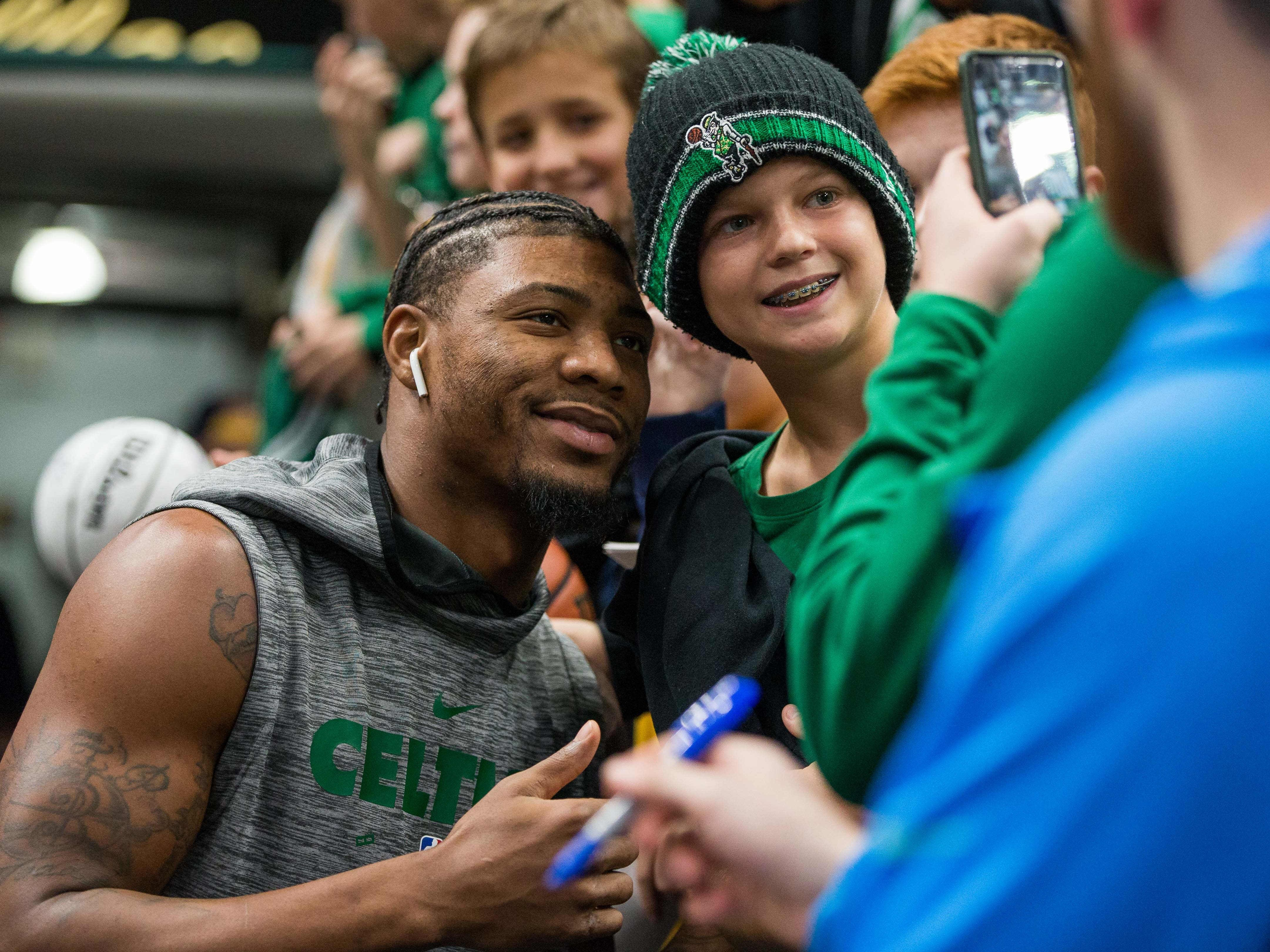 Nov. 3: Celtics guard Marcus Smart poses with a young fan before playing the Pacers in Indianapolis.