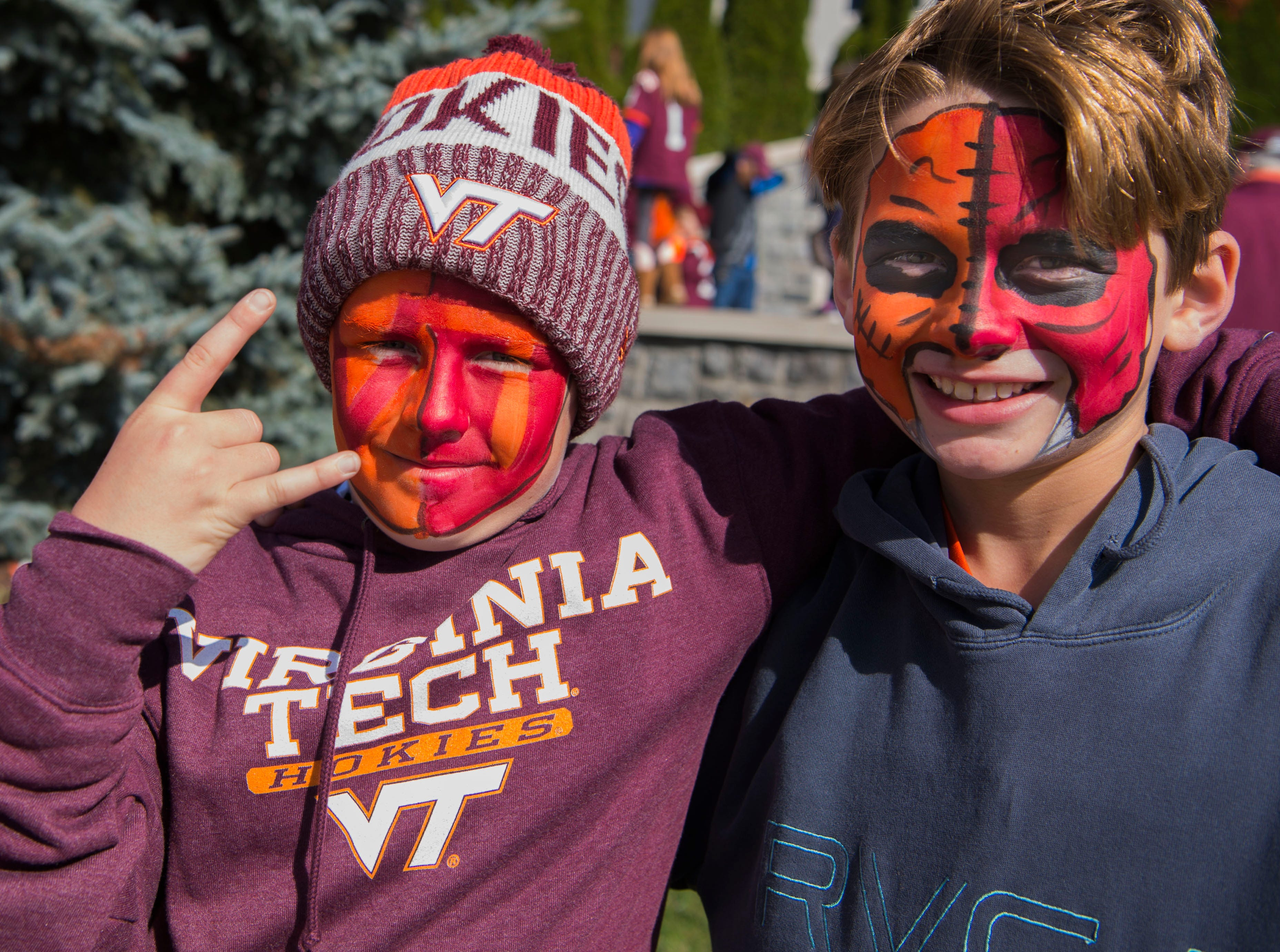 Week 10: A pair of Virginia Tech Hokies fans pose for a photo prior to the game against the Boston College Eagles.