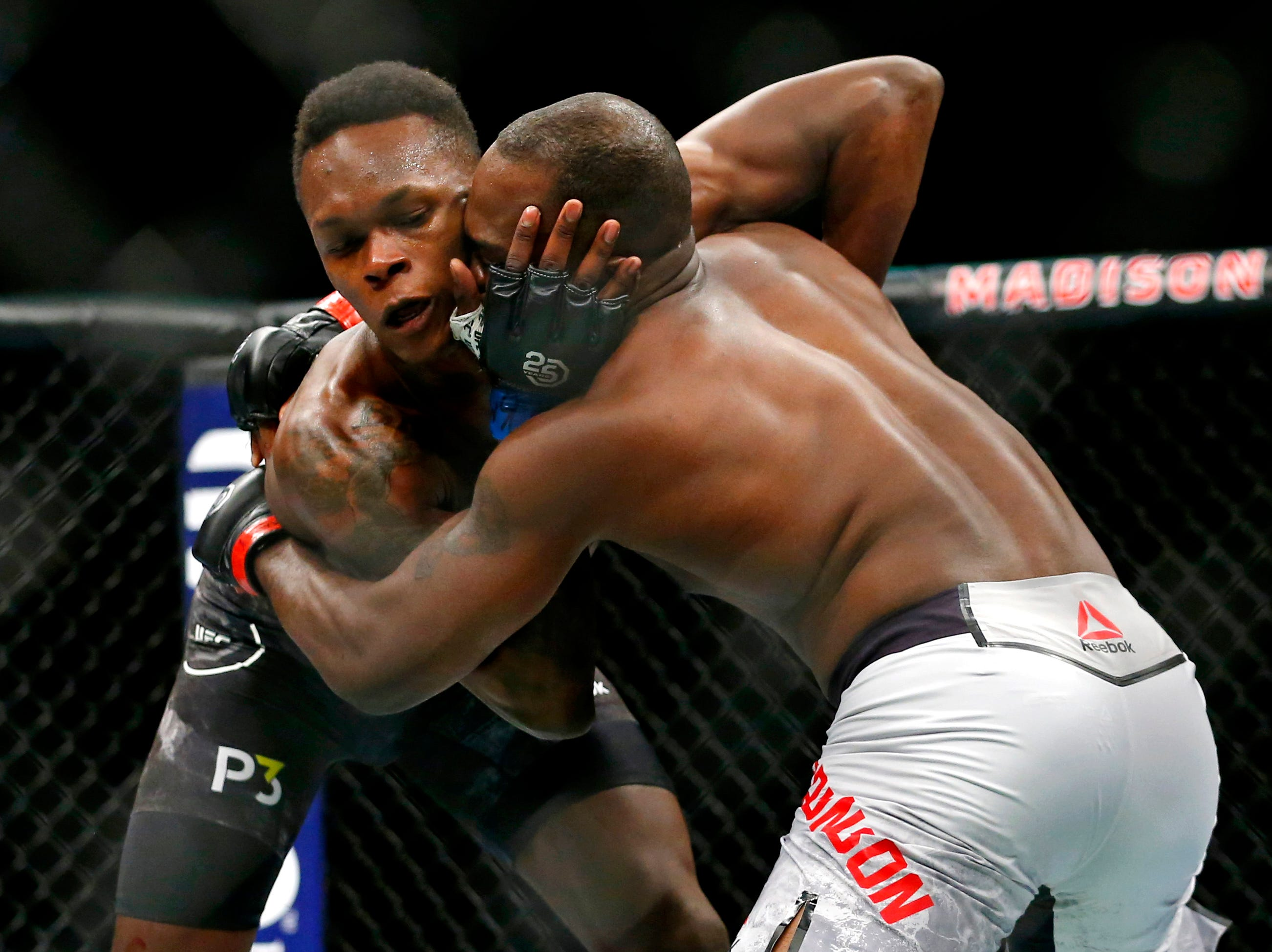 Derek Brunson (red gloves) fights Israel Adesanya (blue gloves) during UFC 230 at Madison Square Garden.