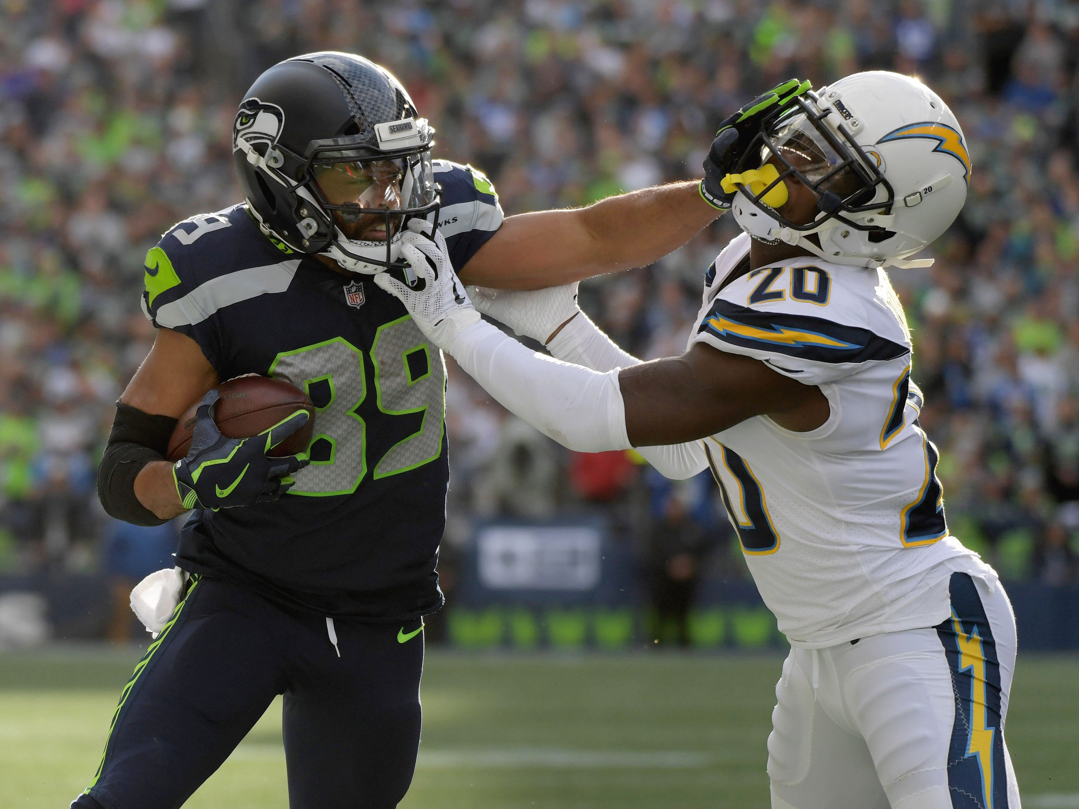 Seattle Seahawks wide receiver Doug Baldwin (89) battles with Los Angeles Chargers defensive back Desmond King (20) in the second quarter at CenturyLink Field.