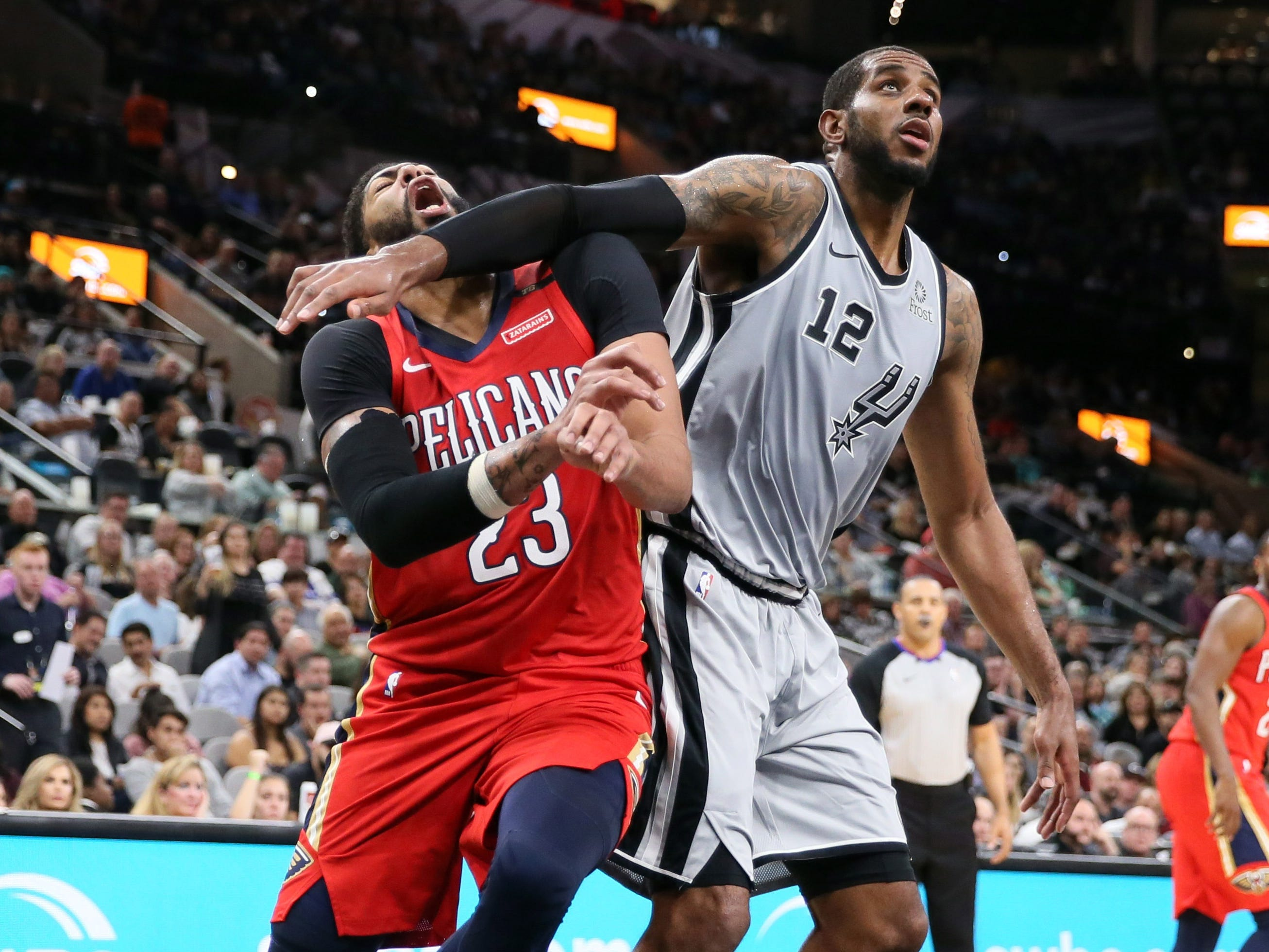 Nov. 3: Pelicans forward Anthony Davis (23) takes a forearm to the chops from Spurs forward LaMarcus Aldridge (12) as they fight for position in the paint during the second half in San Antonio.