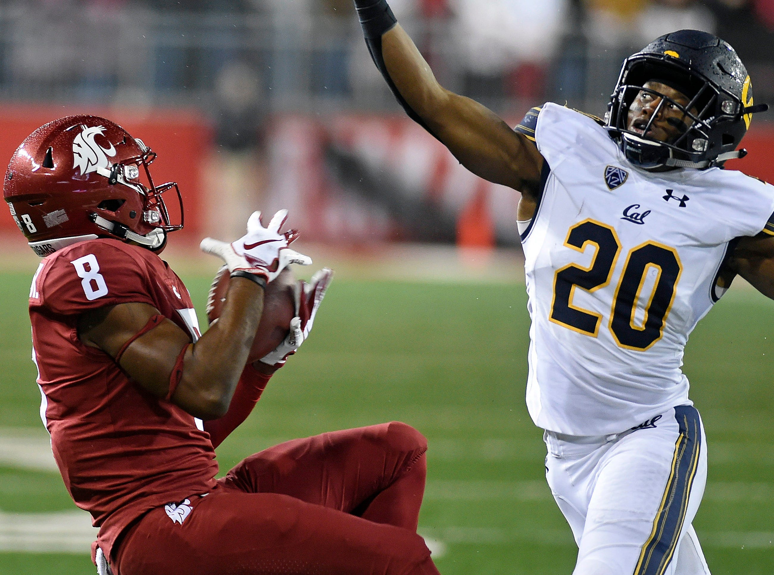 Washington State Cougars wide receiver Easop Winston (8) catches the football against California Golden Bears cornerback Josh Drayden (20) in the second half at Martin Stadium.