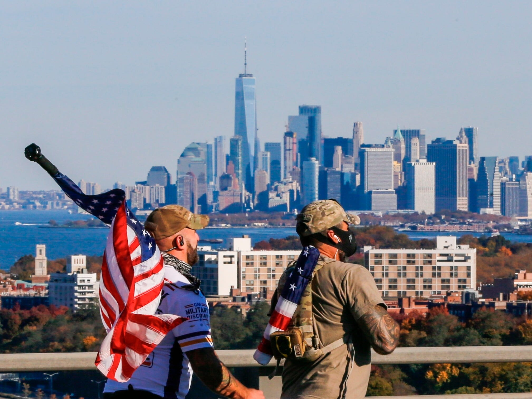 With the One World Trade center in the background, runners cross the Verrazano-Narrows Bridge during the New York City Marathon on Nov. 4.