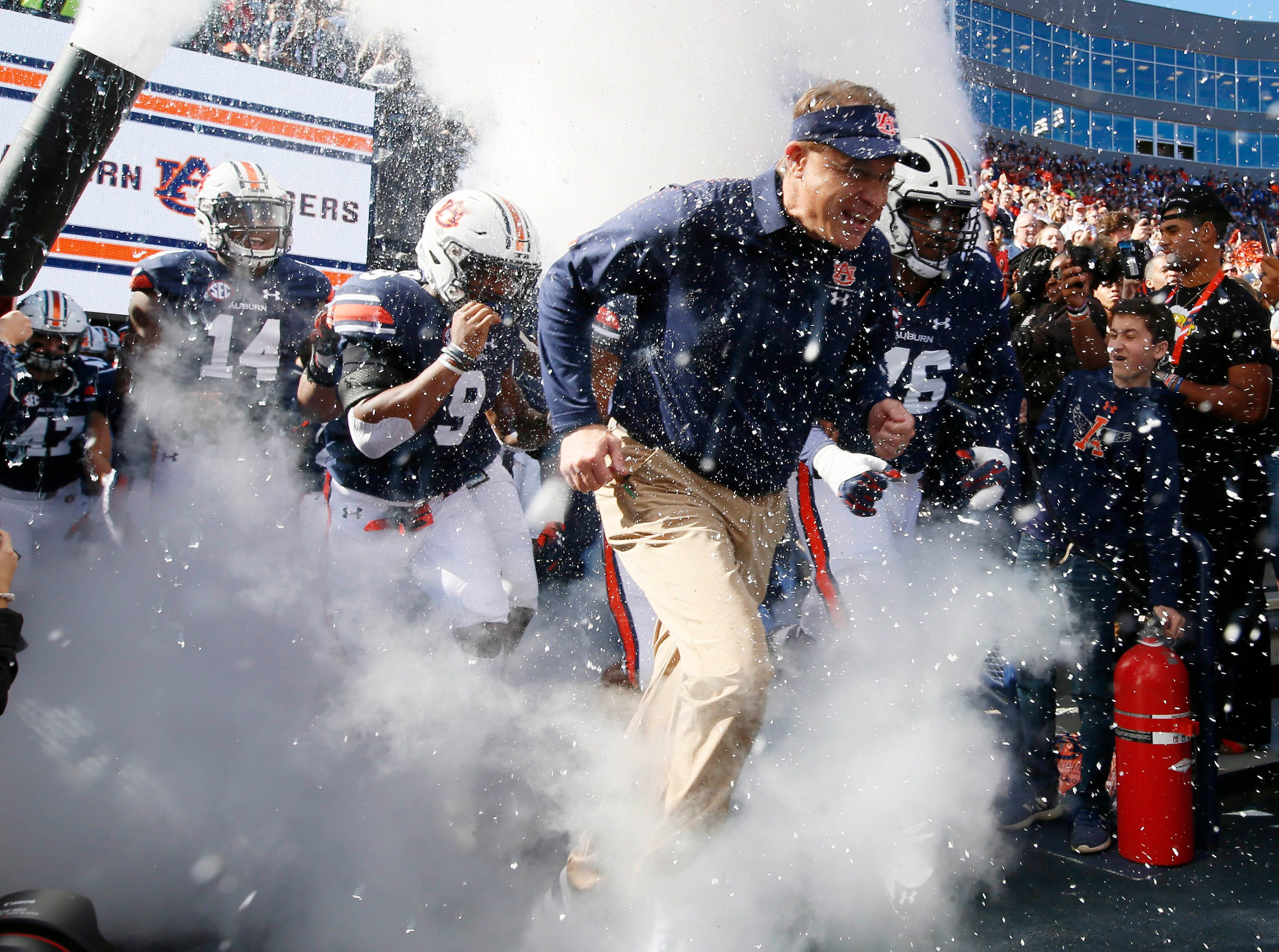 Auburn Tigers head coach Gus Malzahn leads the team onto the field before the game against the Texas A&M Aggies at Jordan-Hare Stadium.