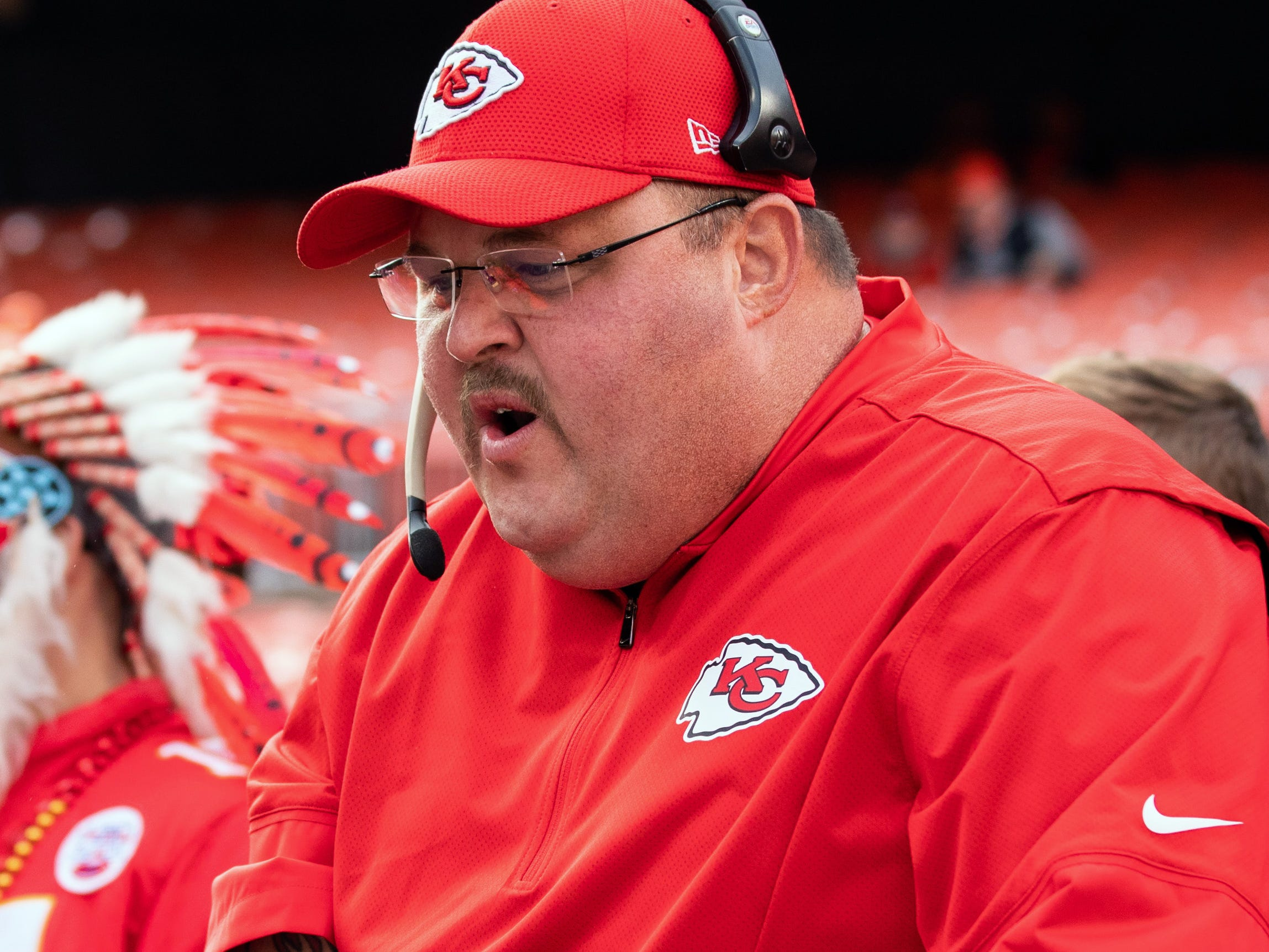 A Kansas City Chiefs fan dressed up as head coach Andy Reid talks with a player during warmups before the game against the Cleveland Browns at FirstEnergy Stadium.