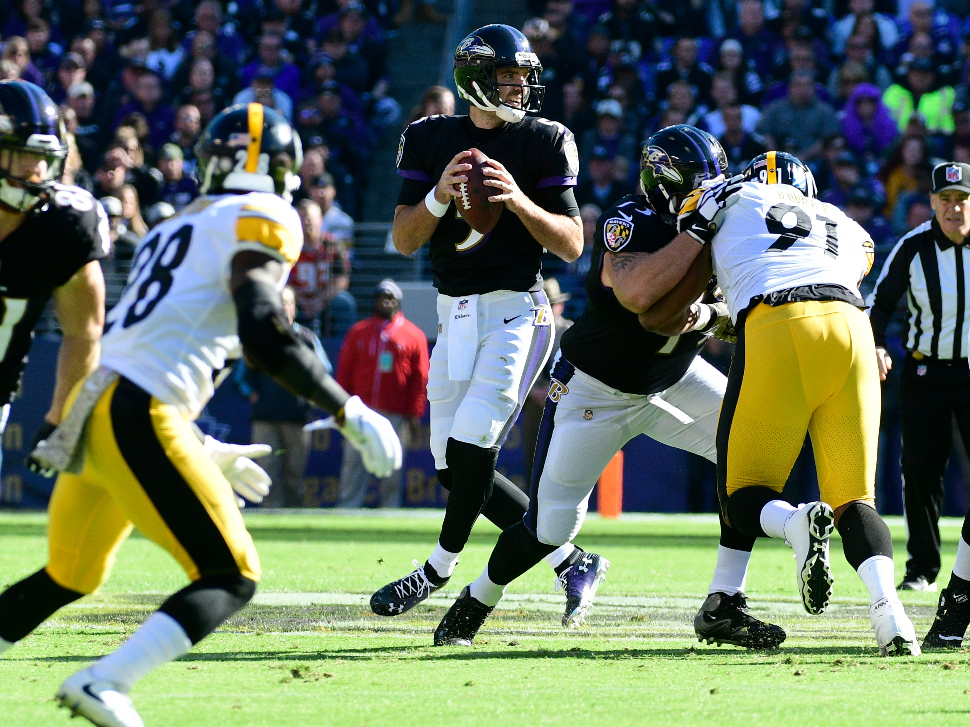 Baltimore Ravens quarterback Joe Flacco (5) in the pocket during the first quarter against the Pittsburgh Steelers at M&T Bank Stadium.
