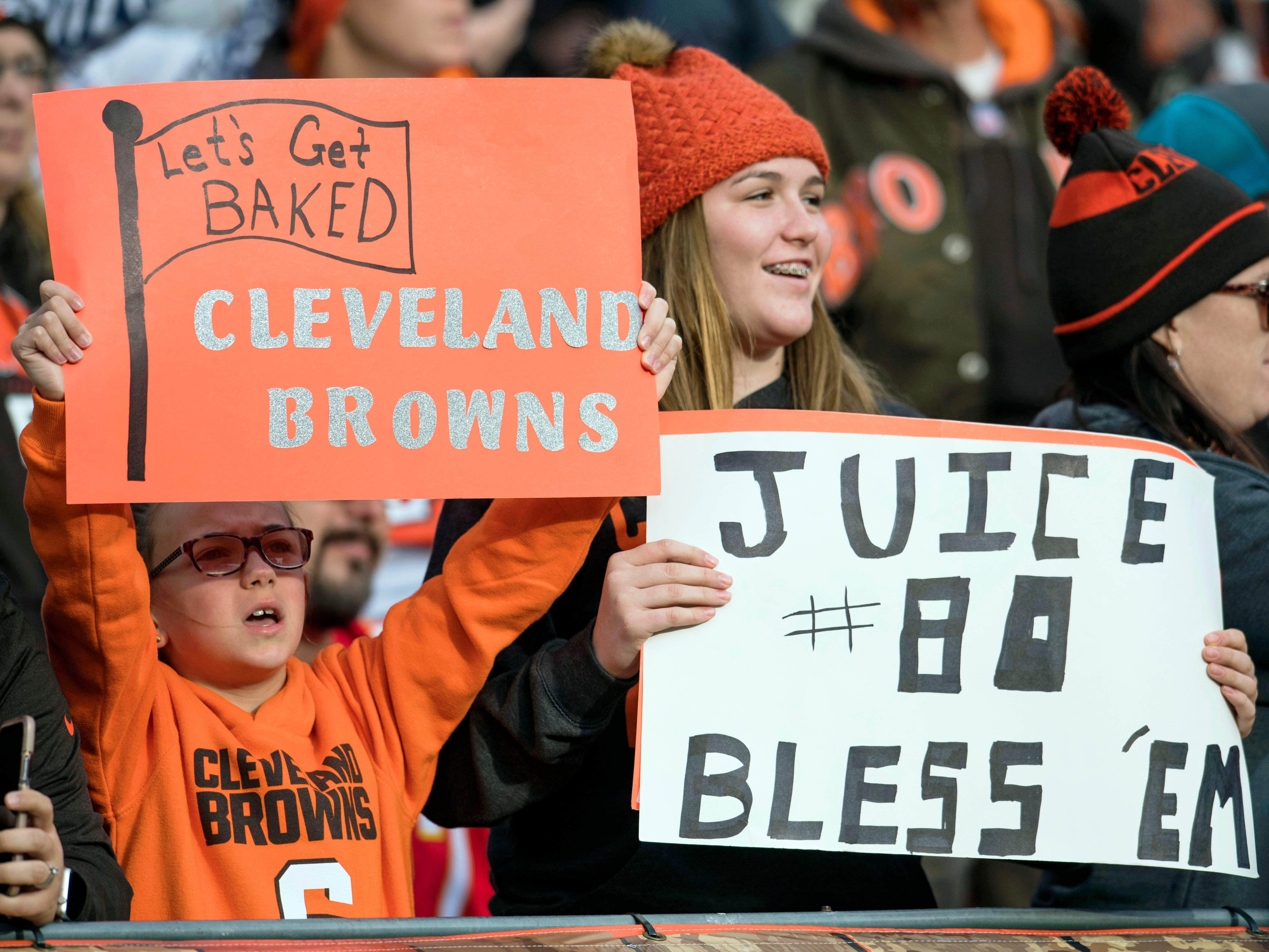 Cleveland Browns fans hold signs for quarterback Baker Mayfield and wide receiver Jarvis Landry during the second half against the Kansas City Chiefs at FirstEnergy Stadium.