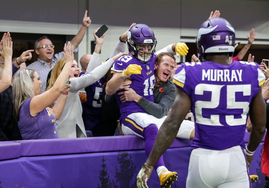 Minnesota Vikings wide receiver Adam Thielen (19) celebrates his touchdown during the second quarter against the Detroit Lions at U.S. Bank Stadium.