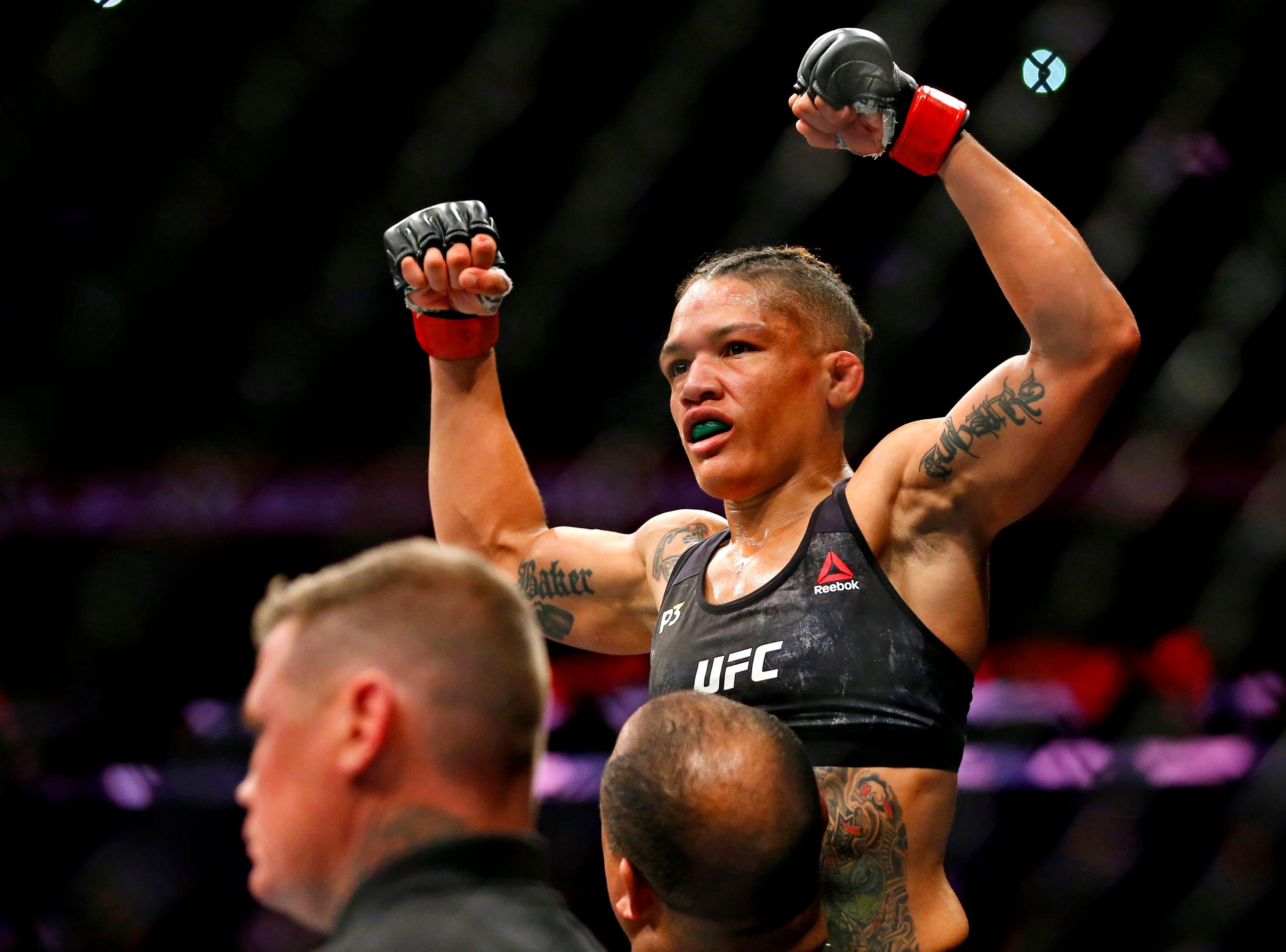 Sijara Eubanks (red gloves) celebrates beating Roxanne Modafferi (blue gloves) during UFC 230 at Madison Square Garden.