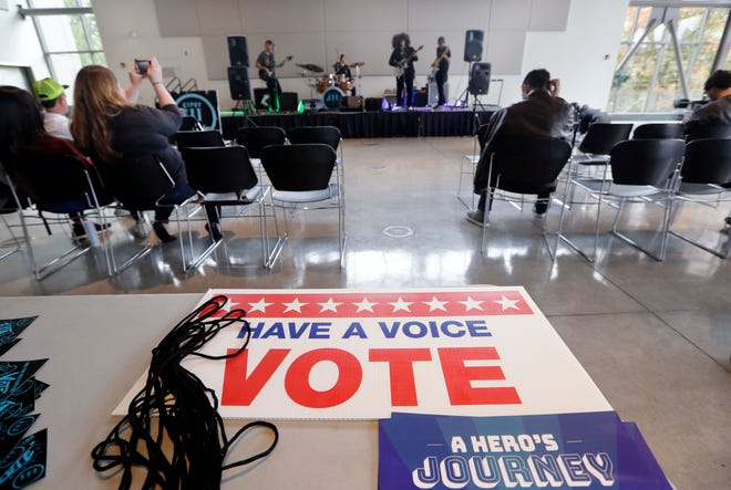A small crowd watches the band Gypsy Temple during a performance by the group at Shoreline Community College in Shoreline, Wash., urging young people to vote Nov. 6. The concert was one of dozens the band has given at high schools and community colleges throughout the state.