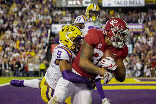 Alabama Crimson Tide tight end Irv Smith Jr. (82) catches a touchdown pass over LSU Tigers safety Grant Delpit (9) during the second quarter at Tiger Stadium.