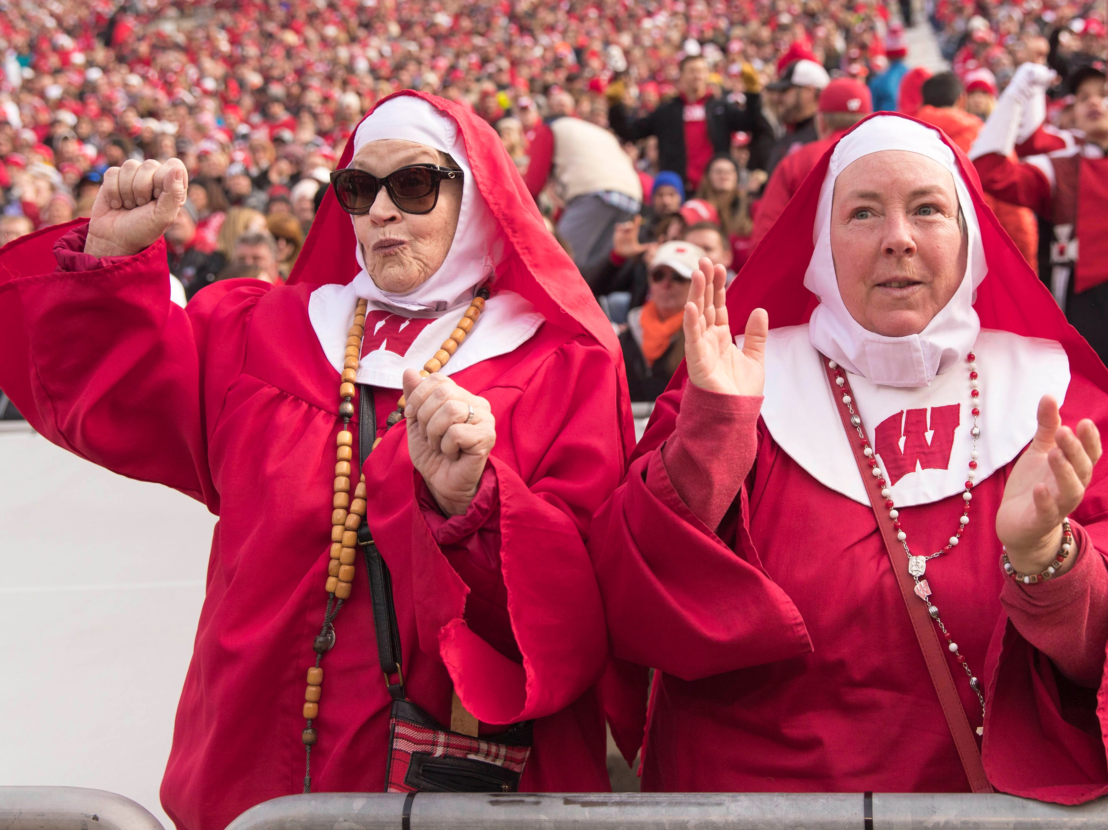 Week 10: Two nuns cheer during the third quarter of the game between the Rutgers Scarlet Knights and Wisconsin Badgers at Camp Randall Stadium.
