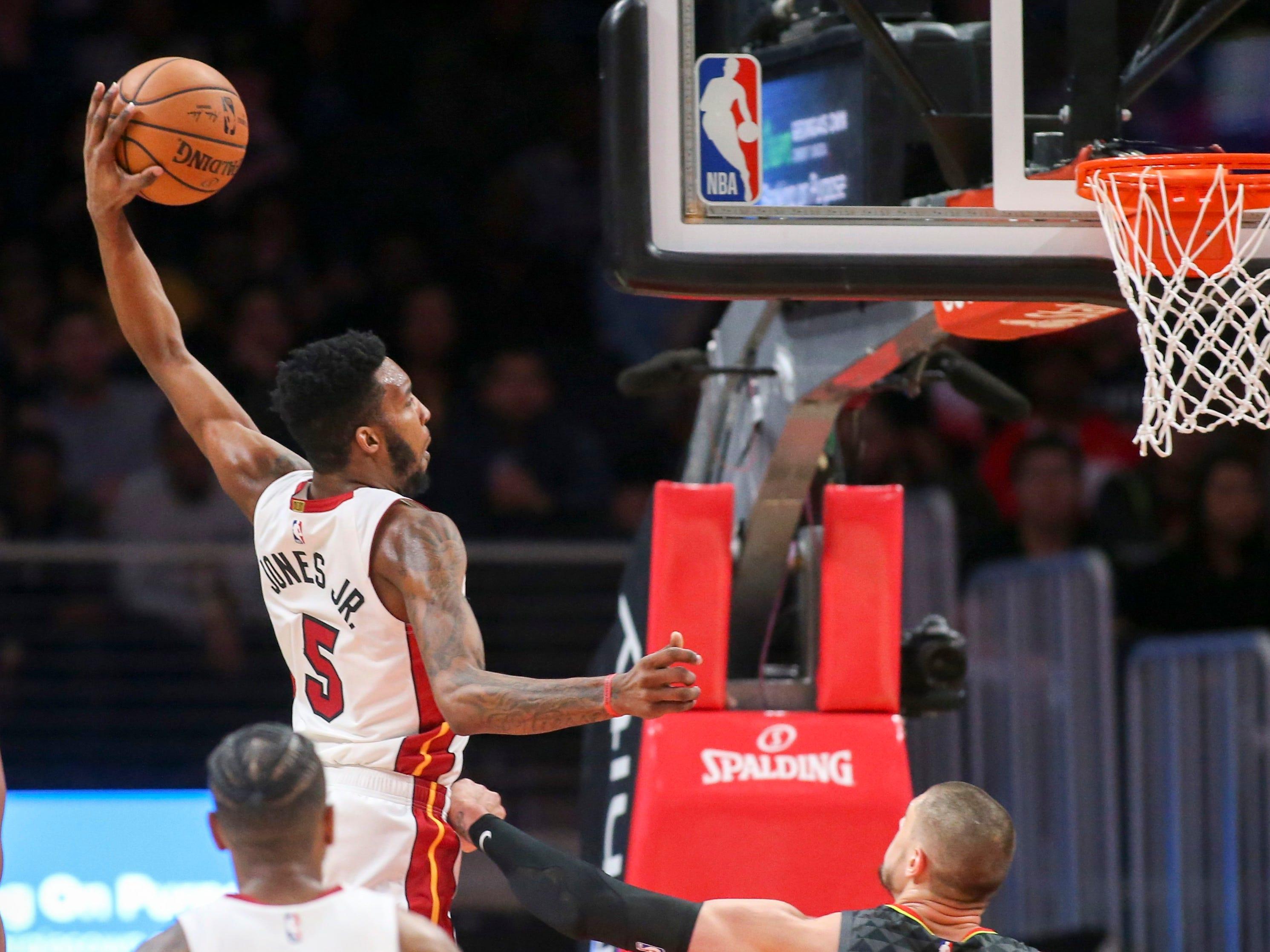 Nov. 3: Heat forward Derrick Jones Jr. (5) takes flight for a one-handed flush against the Hawks in Atlanta.