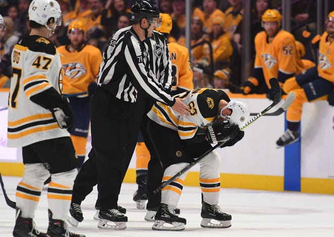 Bruins left wing Brad Marchand reacts after being called for a double minor during the first period against the Predators.