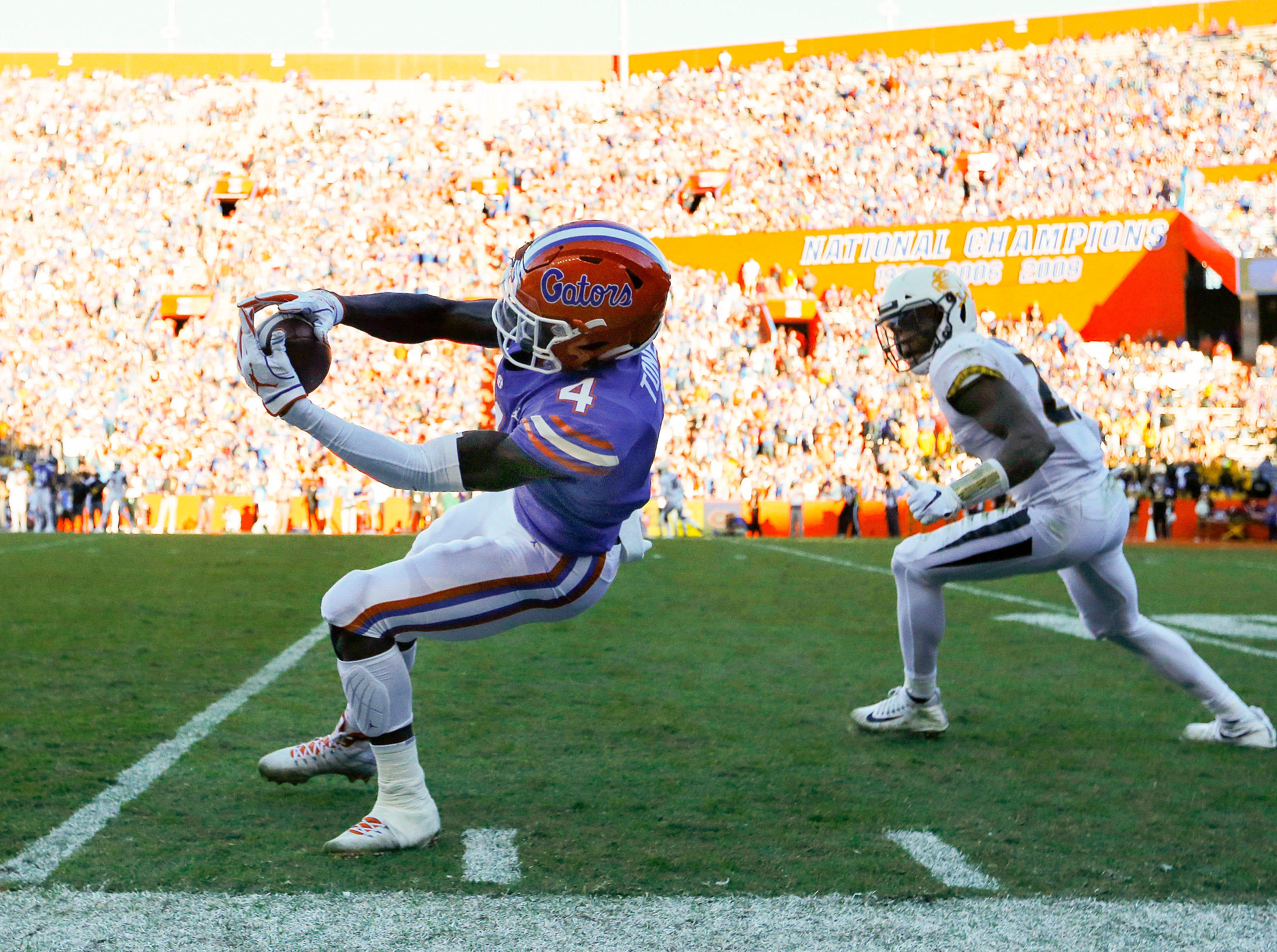 Florida Gators running back Kadarius Toney (4) catches the ball against the Missouri Tigers  during the second quarter at Ben Hill Griffin Stadium.