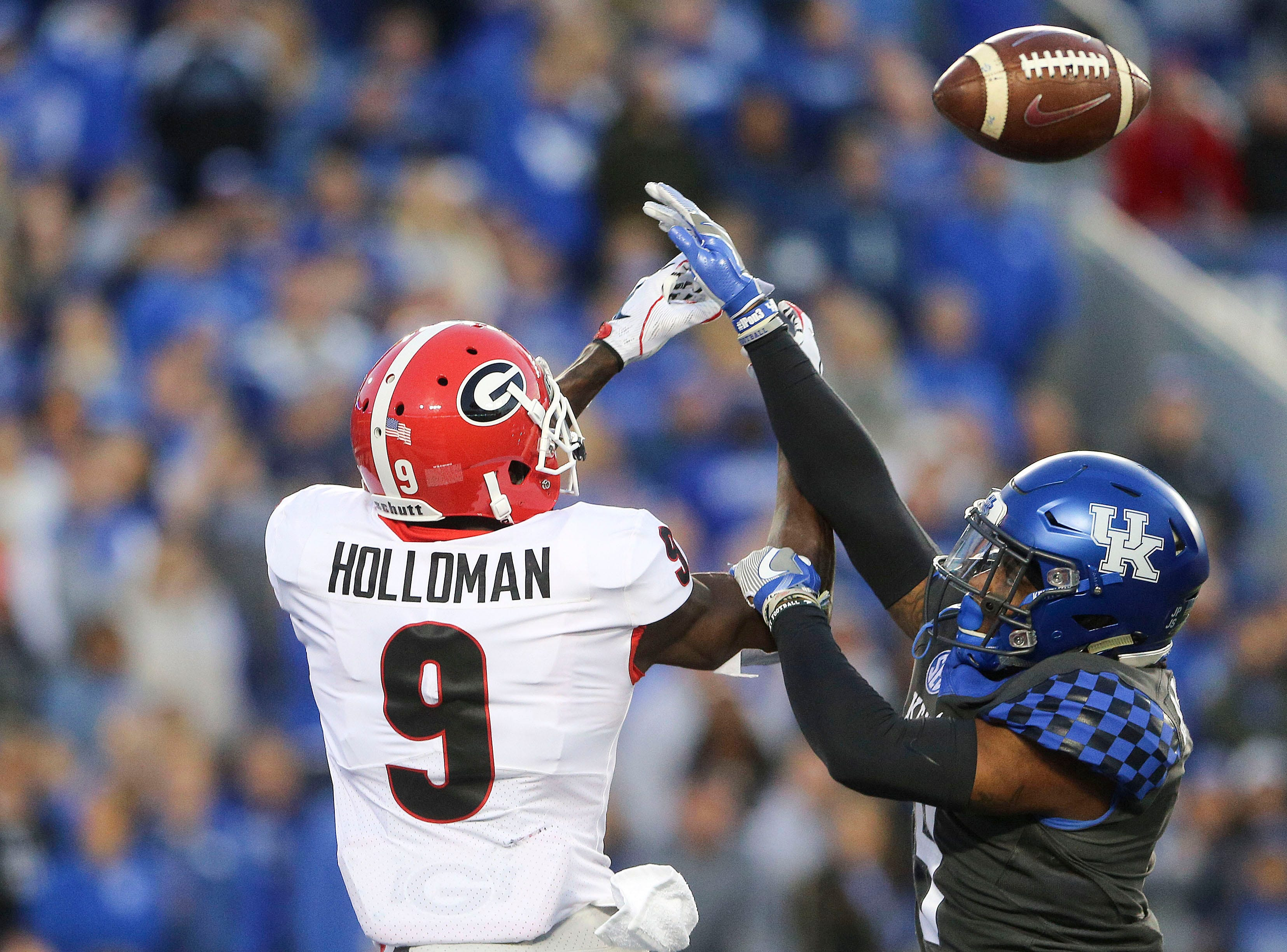 Kentucky Wildcats safety Davonte Robinson (9) breaks up the pass thrown to Georgia Bulldogs wide receiver Jeremiah Holloman (9) in the second half at Kroger Field.