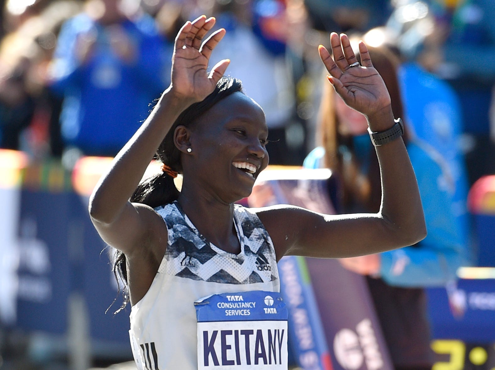 Mary Keitany smiles after crossing the finish line to win the women's division of the 2018 TCS New York City Marathon. It's her fourth title in NYC.