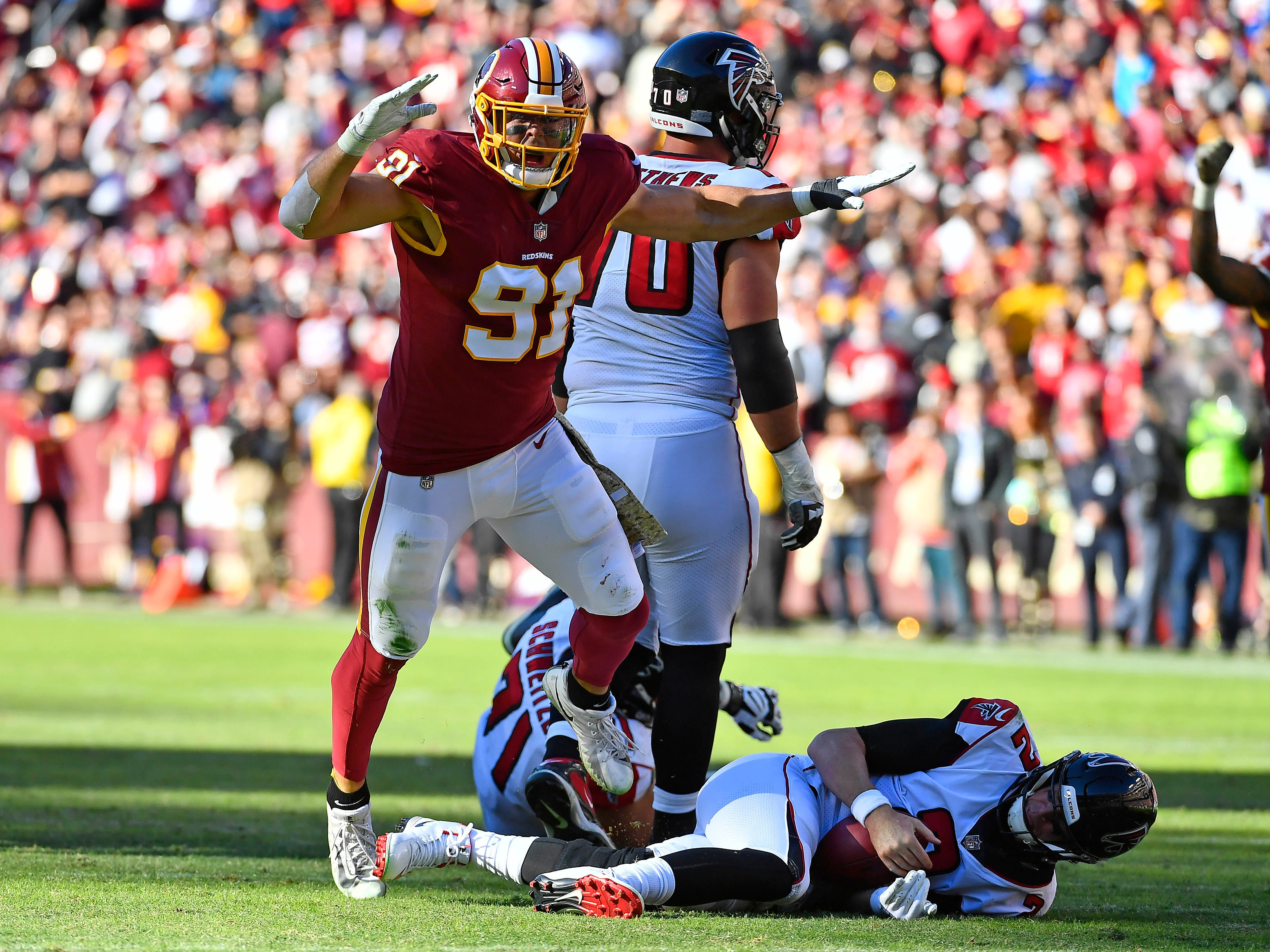 Washington Redskins outside linebacker Ryan Kerrigan (91) celebrates after sacking Atlanta Falcons quarterback Matt Ryan (2) during the first half at FedExField.