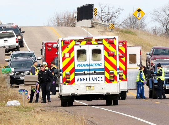 Emergency medical personnel gather at the scene of a hit-and-run crash Saturday in Lake Hallie that killed three girls and an adult.