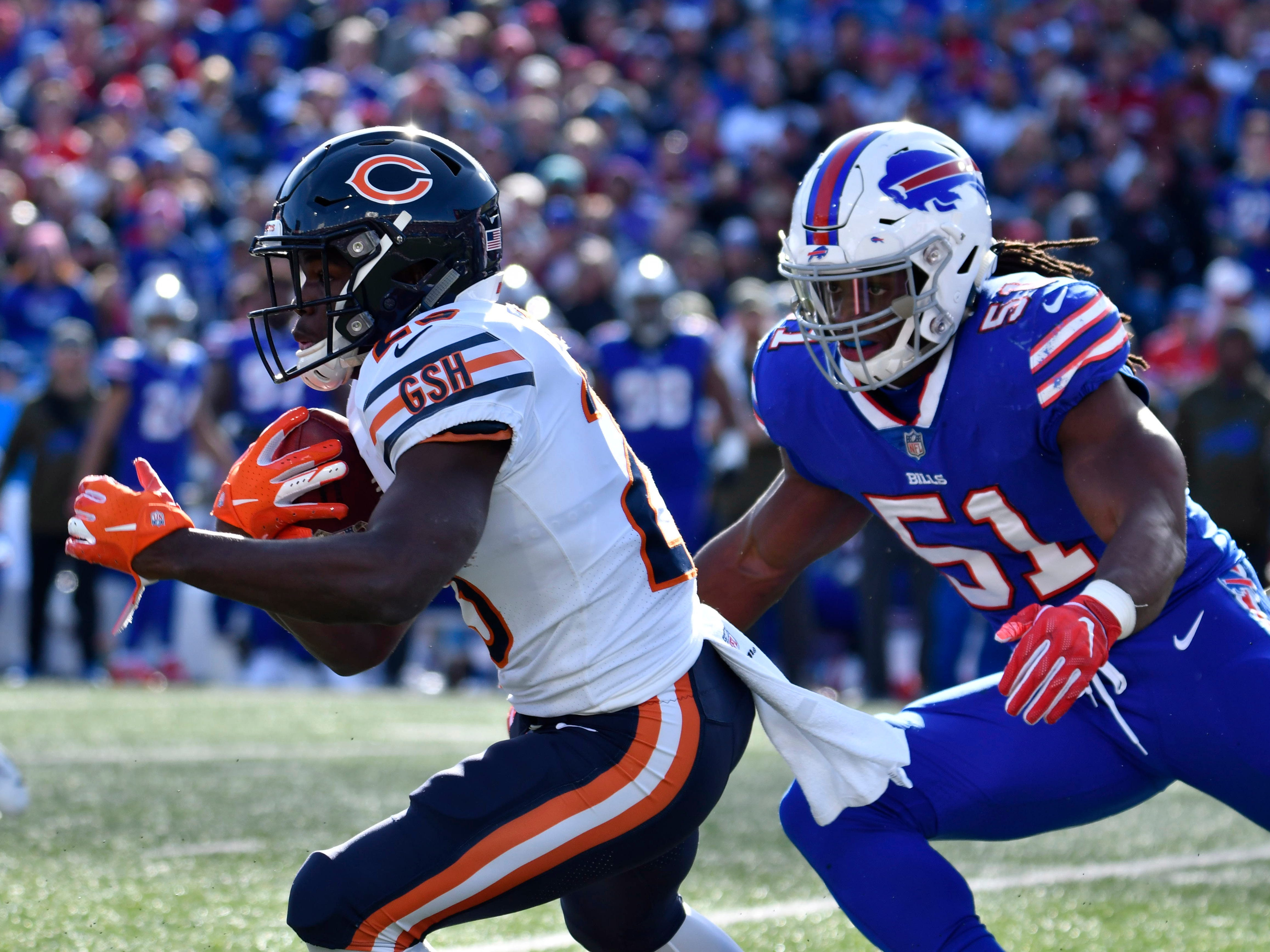 Buffalo Bills linebacker Julian Stanford (51) chases Chicago Bears running back Tarik Cohen (29) during the first quarter at New Era Field.