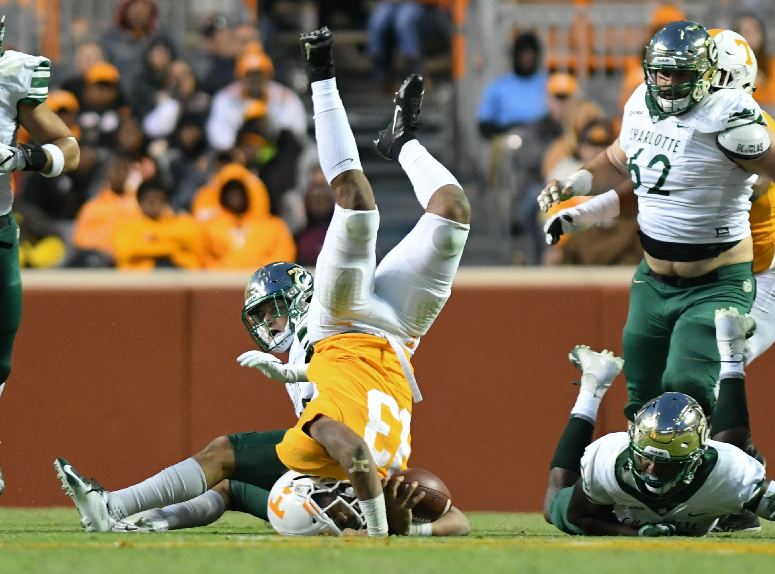 Tennessee Volunteers running back Jeremy Banks (33) is tackled by Charlotte 49ers defensive back Ben DeLuca (28) during the second half at Neyland Stadium.
