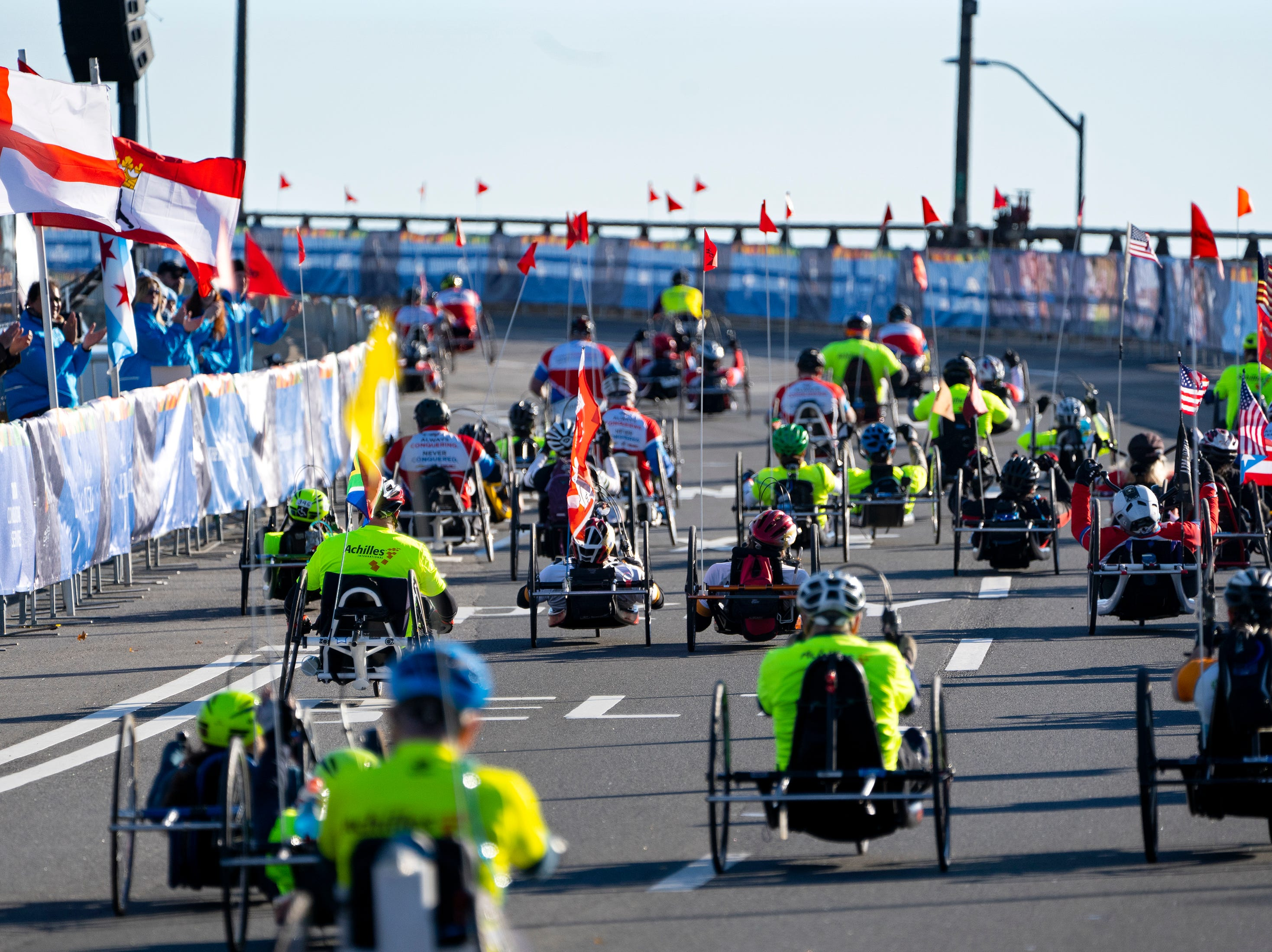 Competitors in the handcycle division leave the starting line during the New York City Marathon on Nov. 4.